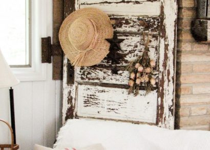 Antique chippy white door becomes functional decor with the addition of barn beam pegs by Prodigal Pieces. www.prodigalpieces.com