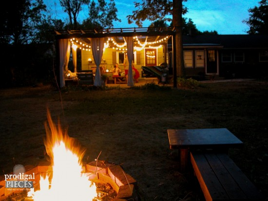 Nighttime view of DIY Patio and Pergola with Firepit by Prodigal Pieces | www.prodigalpieces.com