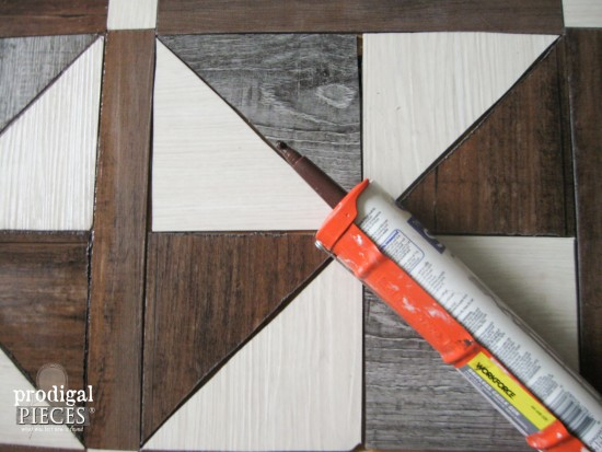 Caulking the seasms in a Barn Wood Quilt DIY by Prodigal Pieces | www.prodigalpieces.com