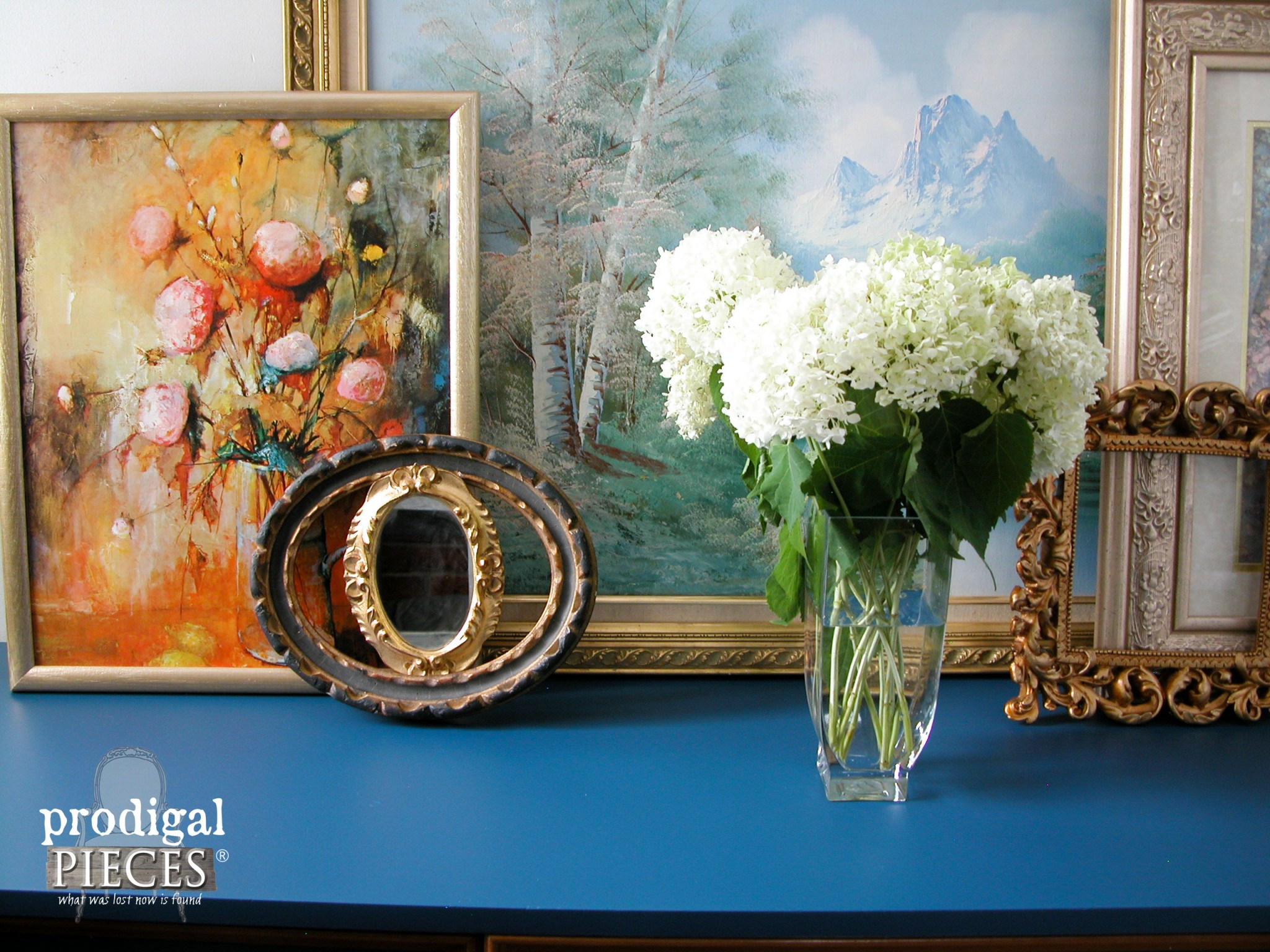Hydrangea and Eclectic Picture Frames Vignette on Blue Dresser by Prodigal Pieces | www.prodigalpieces.com