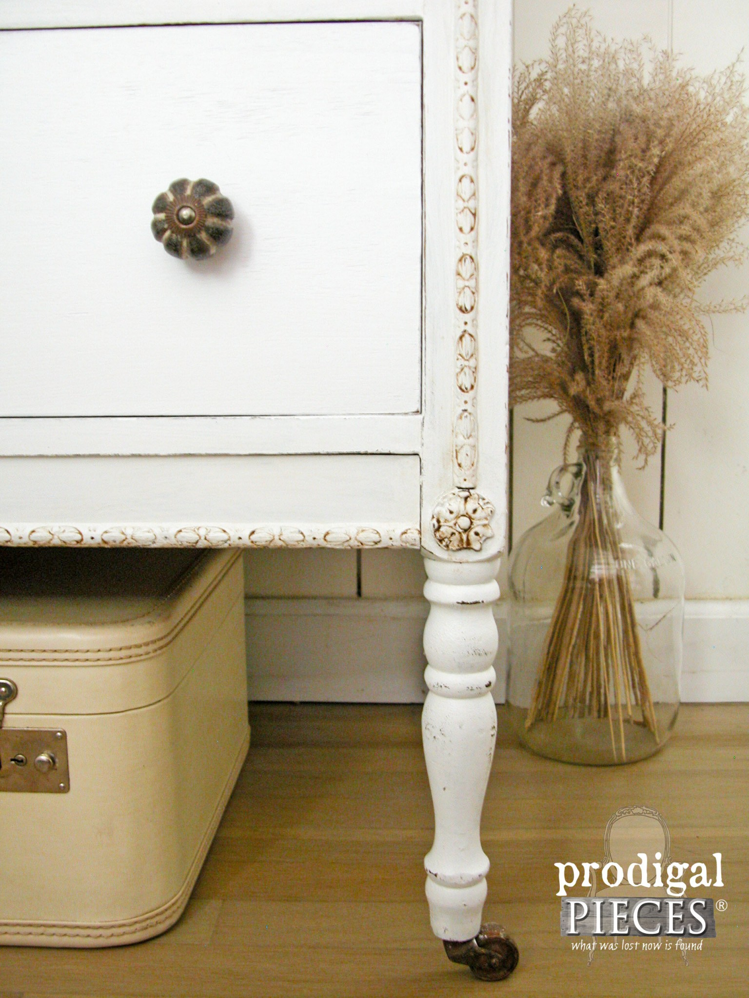 Ornate Details Drawn Our with Dark Wax and Feature Rustic Brands Knobs by Prodigal Pieces | www.prodigalpieces.com