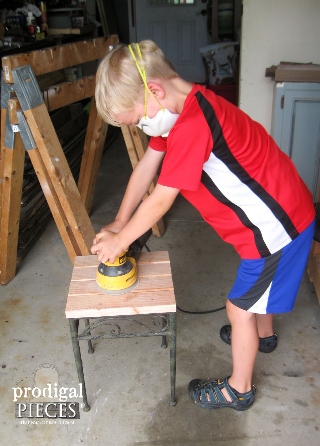 Boy Sanding Outdoor Table Top | Prodigal Pieces | www.prodigalpieces.com