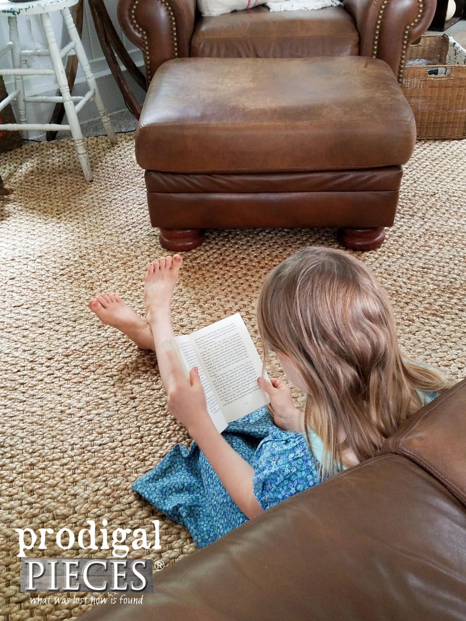 Girl Sitting on Jute Area Rug Reading | Prodigal Pieces | www.prodigalpieces.com