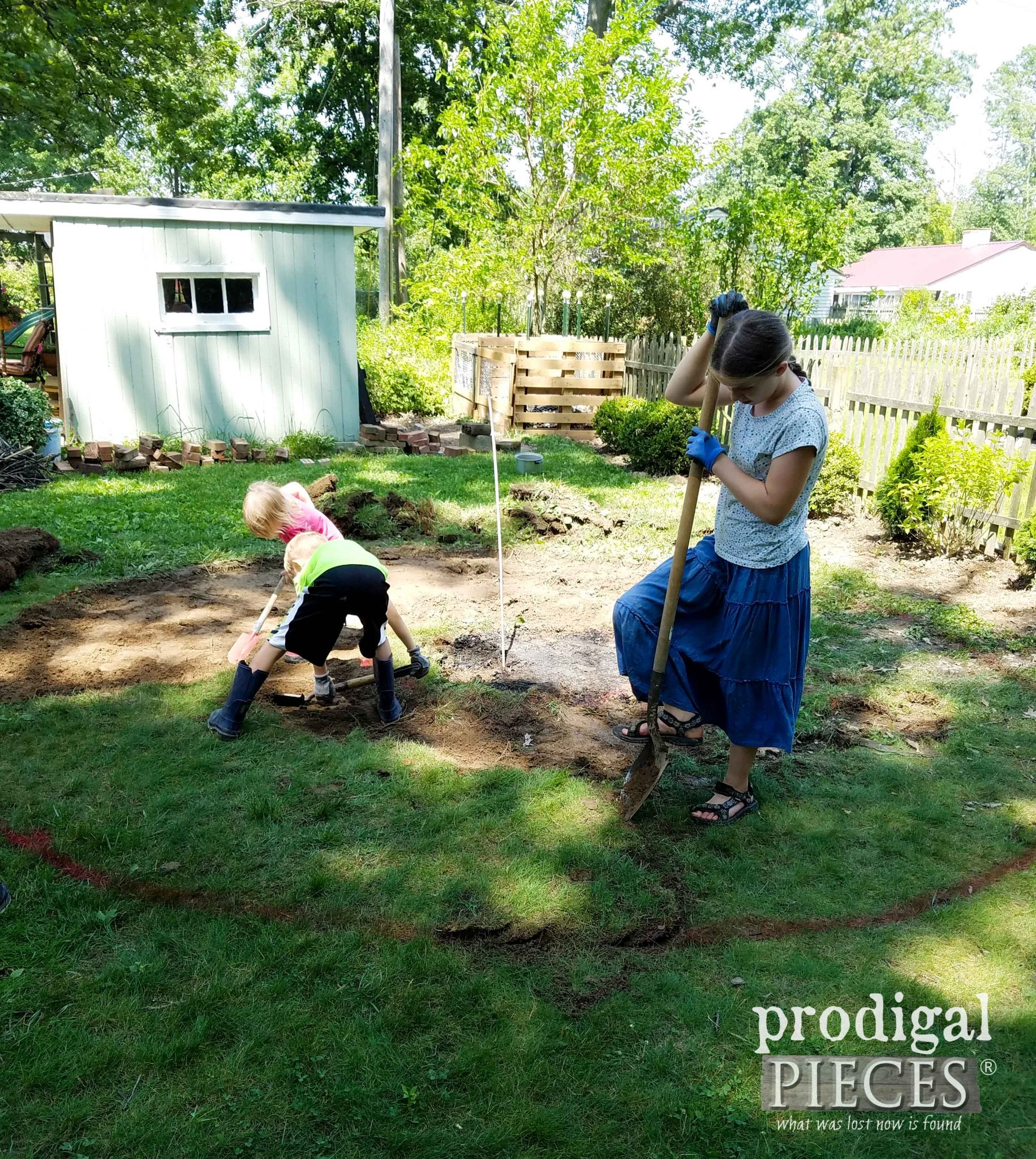 Kids Helping Remove Sod for DIY Fire Pit | prodigalpieces.com