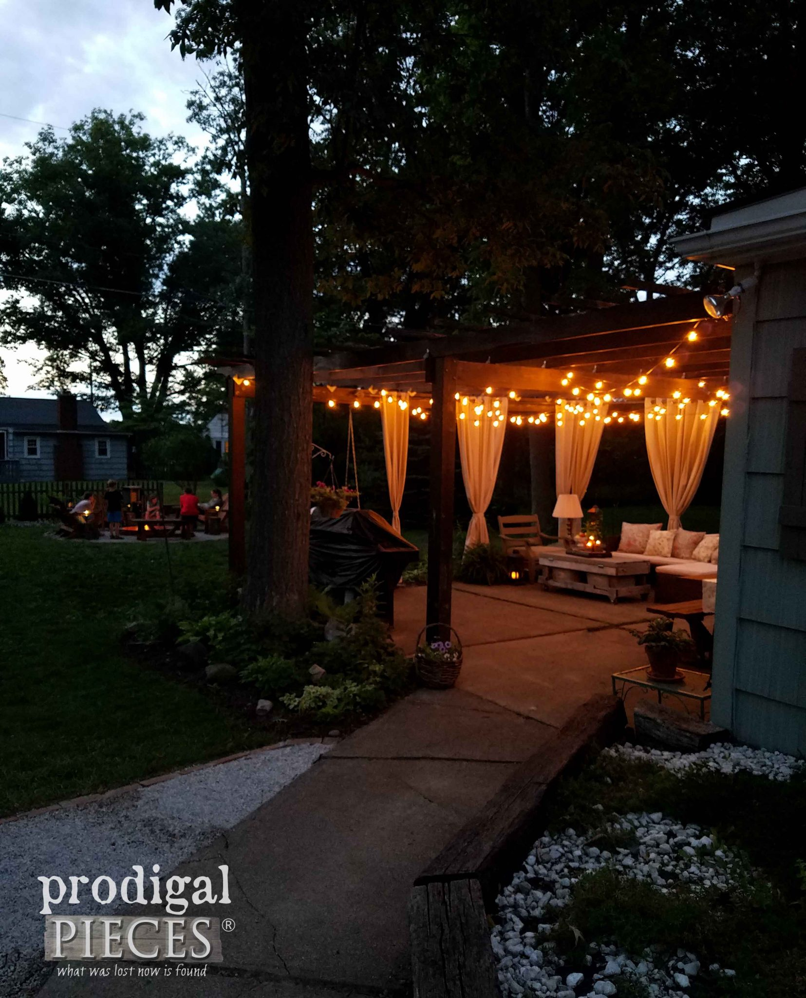 Patio with Nighttime Lights and DIY Fire Pit by Prodigal Pieces | prodigalpieces.com
