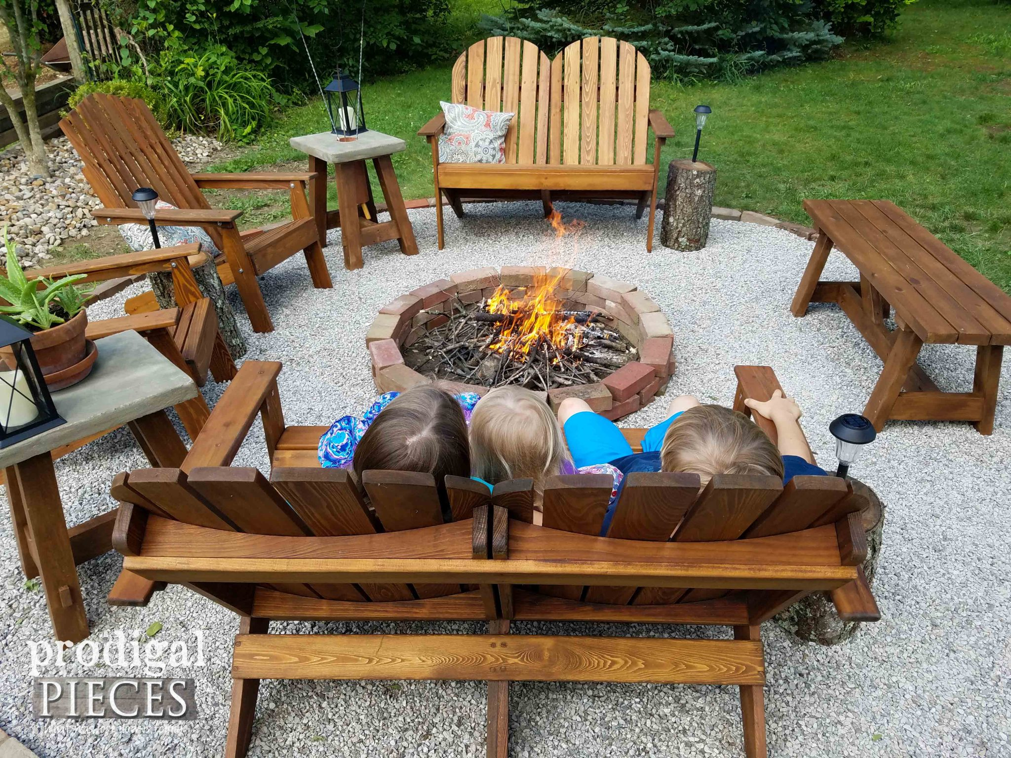 Kids Relaxing in Backyard Fire Pit | prodigalpieces.com