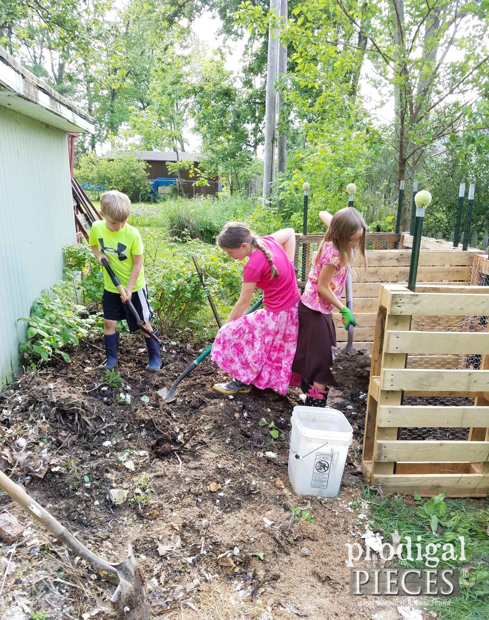 Moving Compost into Pallet Compost Bin by Prodigal Pieces | prodigalpieces.com