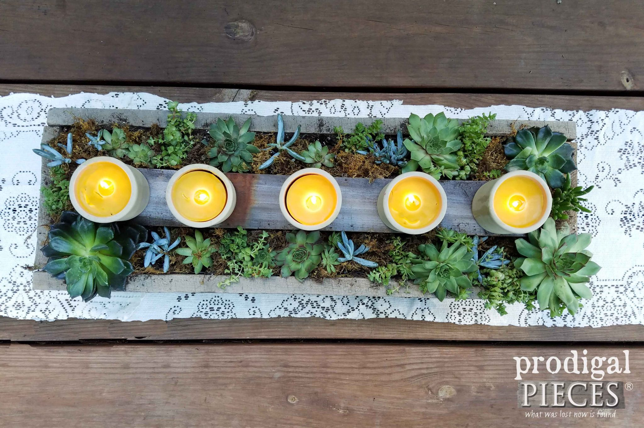 Homemade Beeswax Candles in Succulent Centerpiece by Prodigal Pieces | prodgalpieces.com