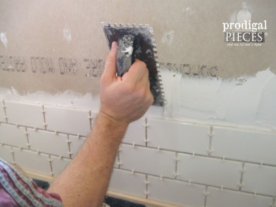 Installing White Subway Tile in Bathroom by Prodigal Pieces | www.prodigalpieces.com