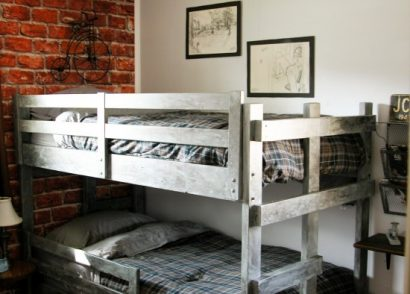 A teen boys' room gets a vintage industrial makeover with faux brick wallpaper, metal accents, and secret hidden storage. Come take the tour! by Prodigal Pieces www.prodigalpieces.com #prodigalpieces
