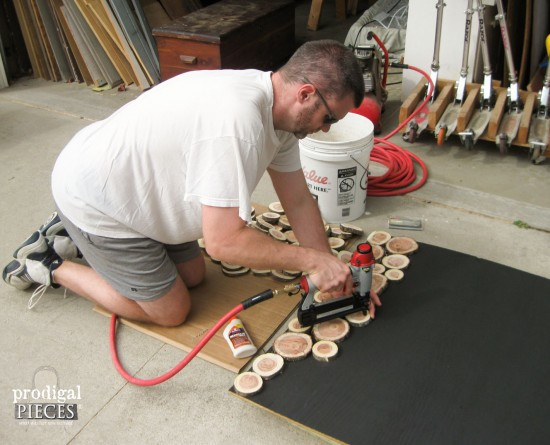 Nailing Wood Slices on Faux Fireplace | prodigalpieces.com