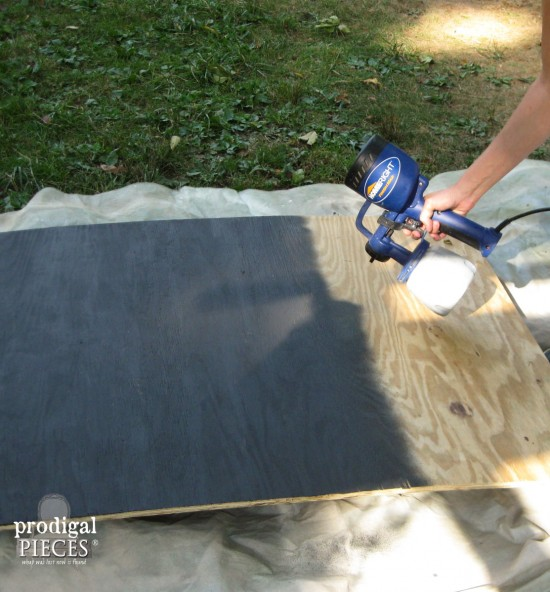 Spray Painting Wood Back on DIY Faux Fireplace by Prodigal Pieces | prodigalpieces.com
