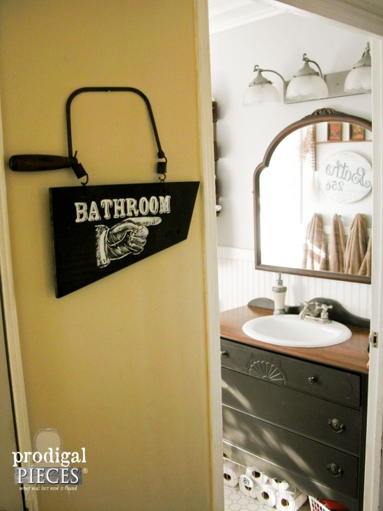 Bits and pieces of reclaimed parts fit perfectly together to make a rustic bathroom directional sign by Prodigal Pieces www.prodigalpieces.com #prodigalpieces