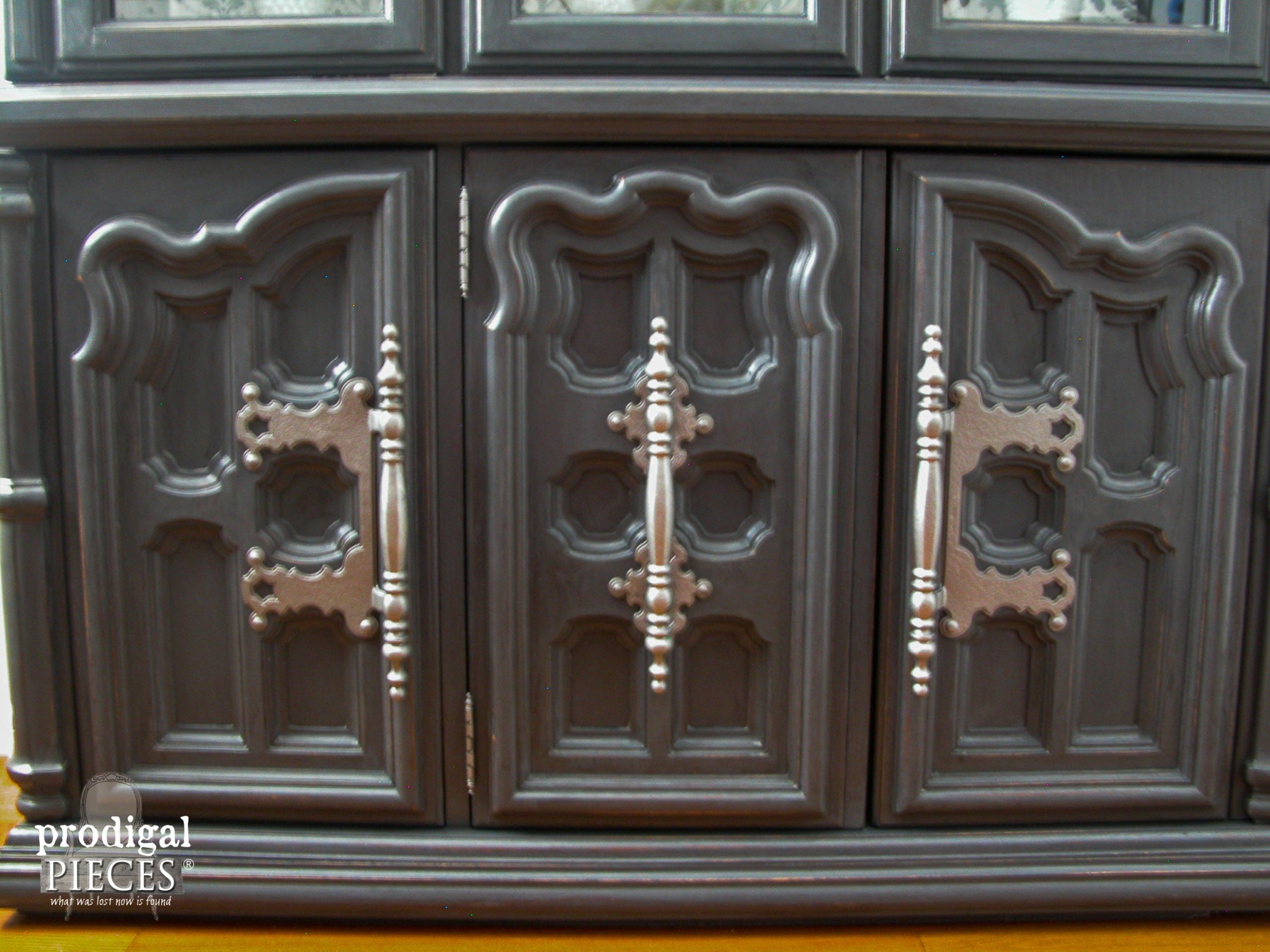 Ornate Woodwork on Wallpapered China Cabinet by Prodigal Pieces | www.prodigalpieces.com