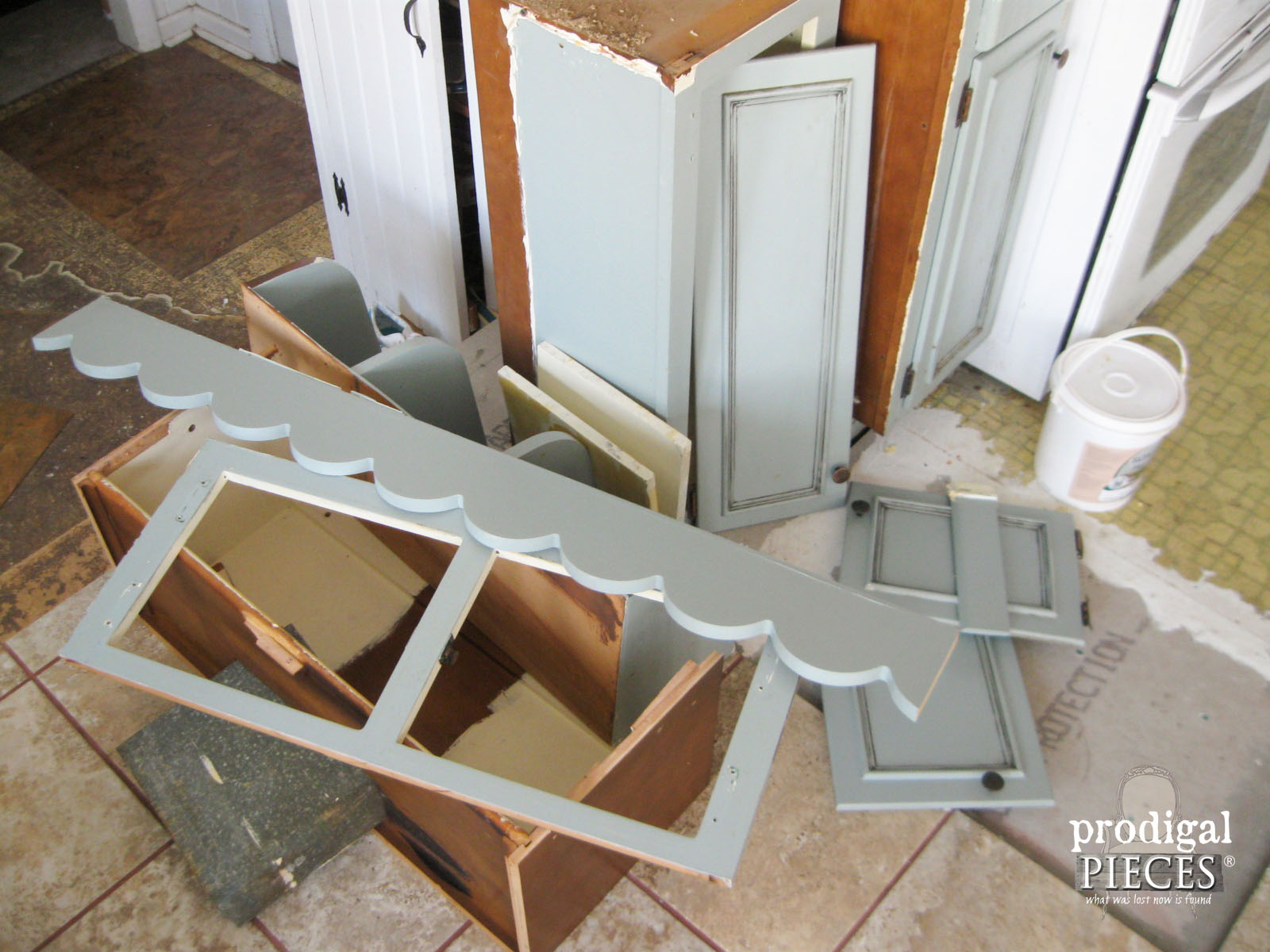 Pile of Discarded Kitchen Cabinets for Repurpose by Prodigal Pieces | www.prodigalpieces.com