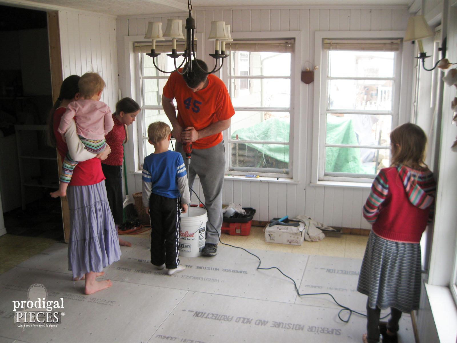Kids Watching While Dad Mixes Mortar for Tile Floor | Prodigal Pieces | www.prodigalpieces.com