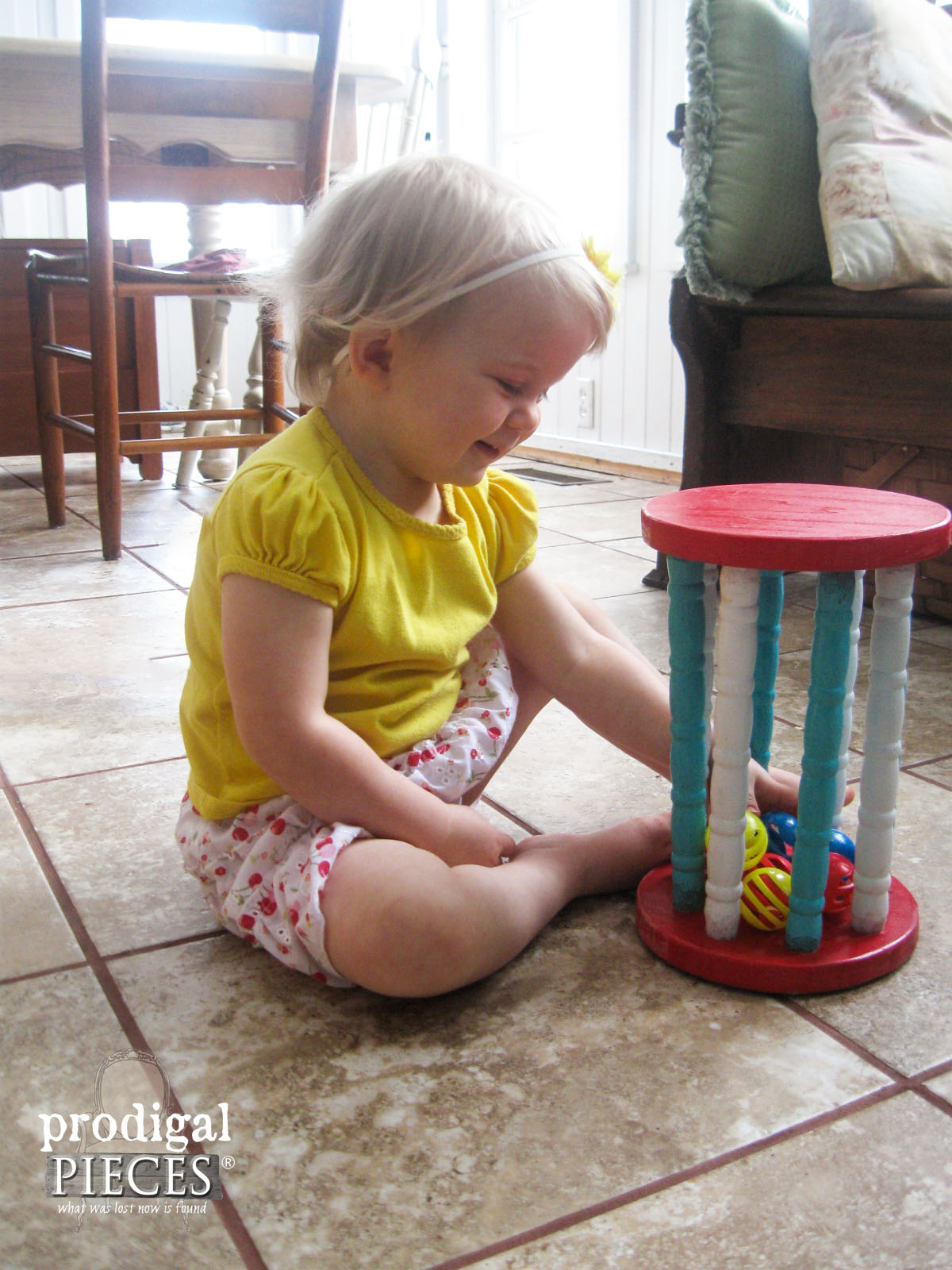 Little Girl Playing with Reclaimed Wooden Toy by Prodigal Pieces | www.prodigalpieces.com
