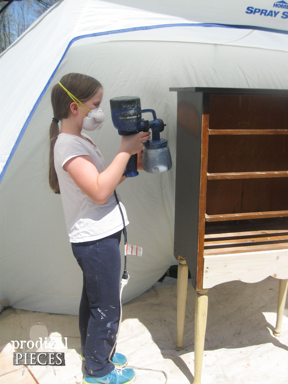 Girl Using HomeRight Finish Max in HomeRight Spray Shelter | Prodigal Pieces | www.prodigalpieces.com