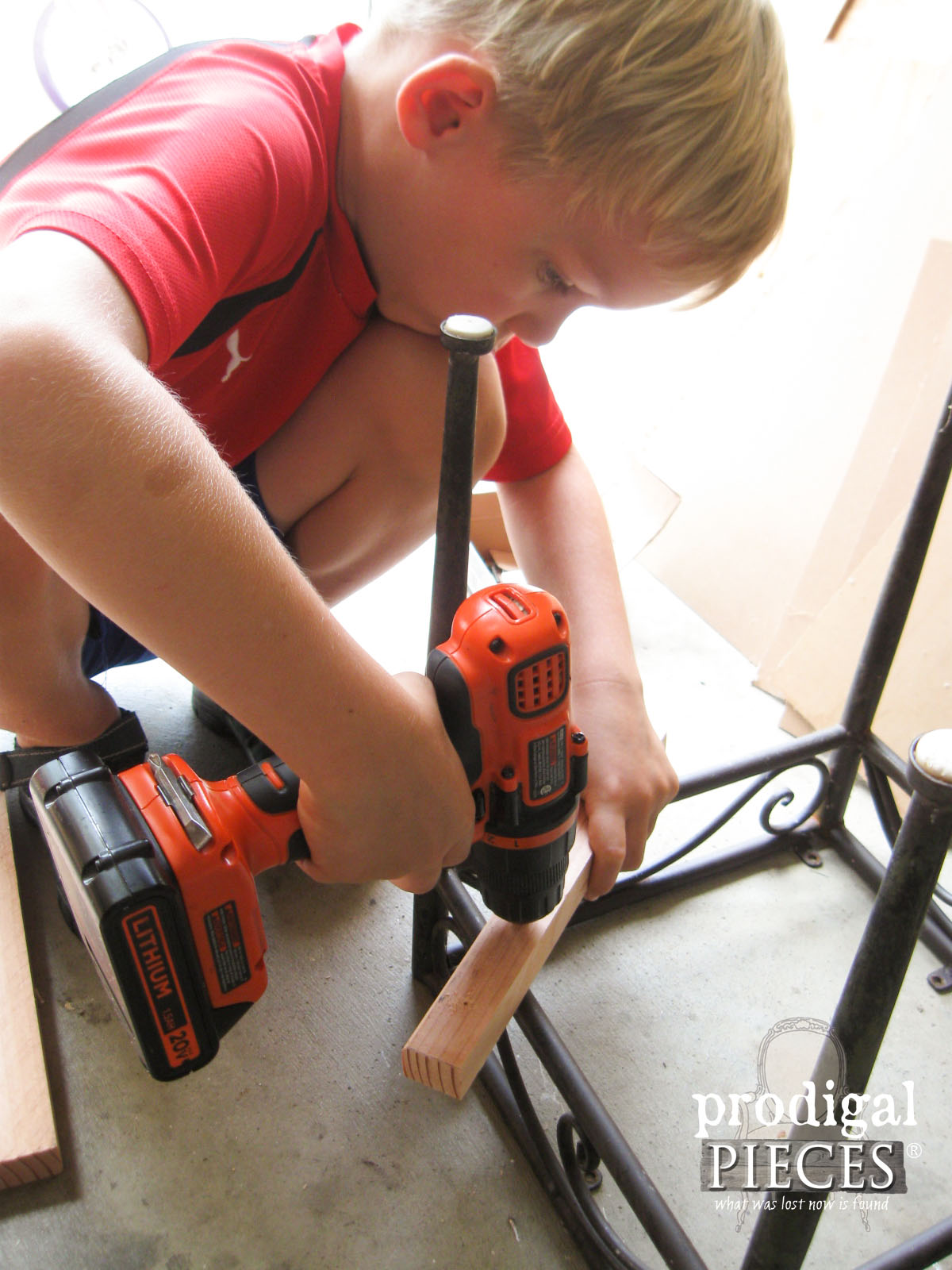 Boy Drilling New Wood for Outdoor Table | Prodigal Pieces | www.prodigalpieces.com