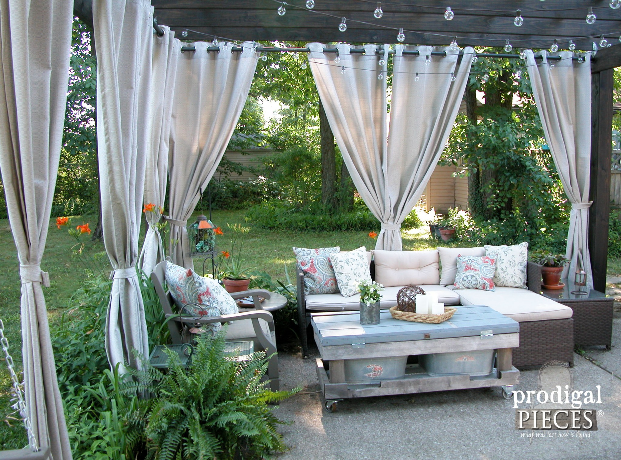Seating Area with Outdoor Curtains on Pergola by Prodigal Pieces | www.prodigalpieces.com