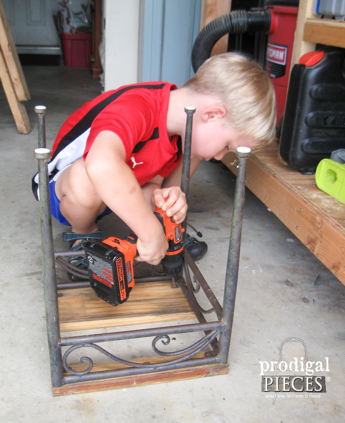 Little Boy Working on Outdoor Decor Table | Prodigal Pieces | www.prodigalpieces.com