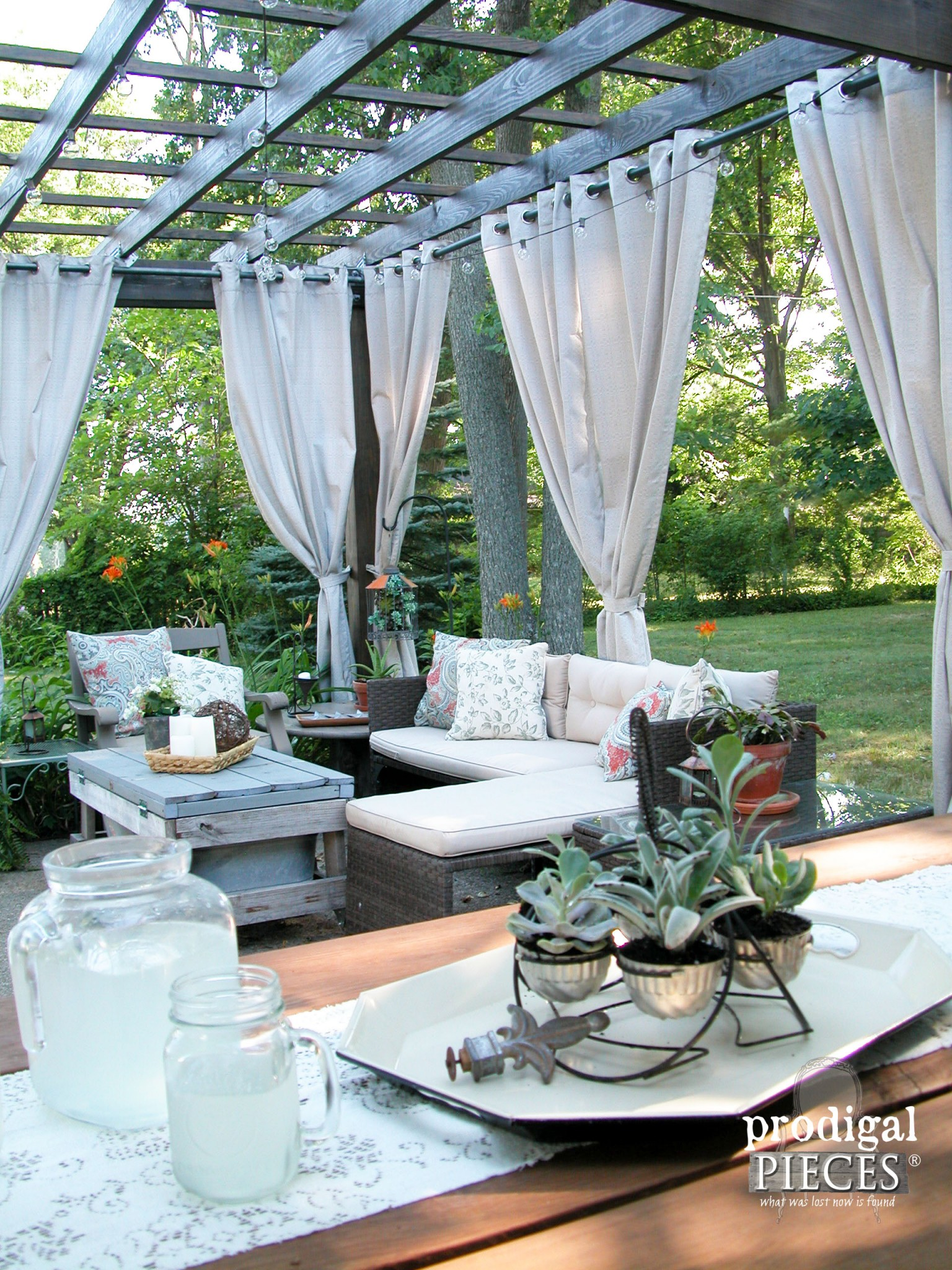 DIY Patio Design with Pergola, Curtains, and Repurposed Furniture by Prodigal Pieces | www.prodigalpieces.com