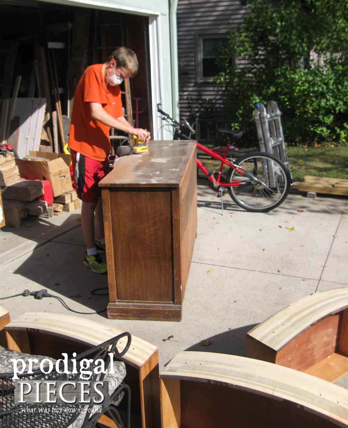 Teen Boy Sanding Vintage Buffet | Prodigal Pieces | www.prodigalpieces.com