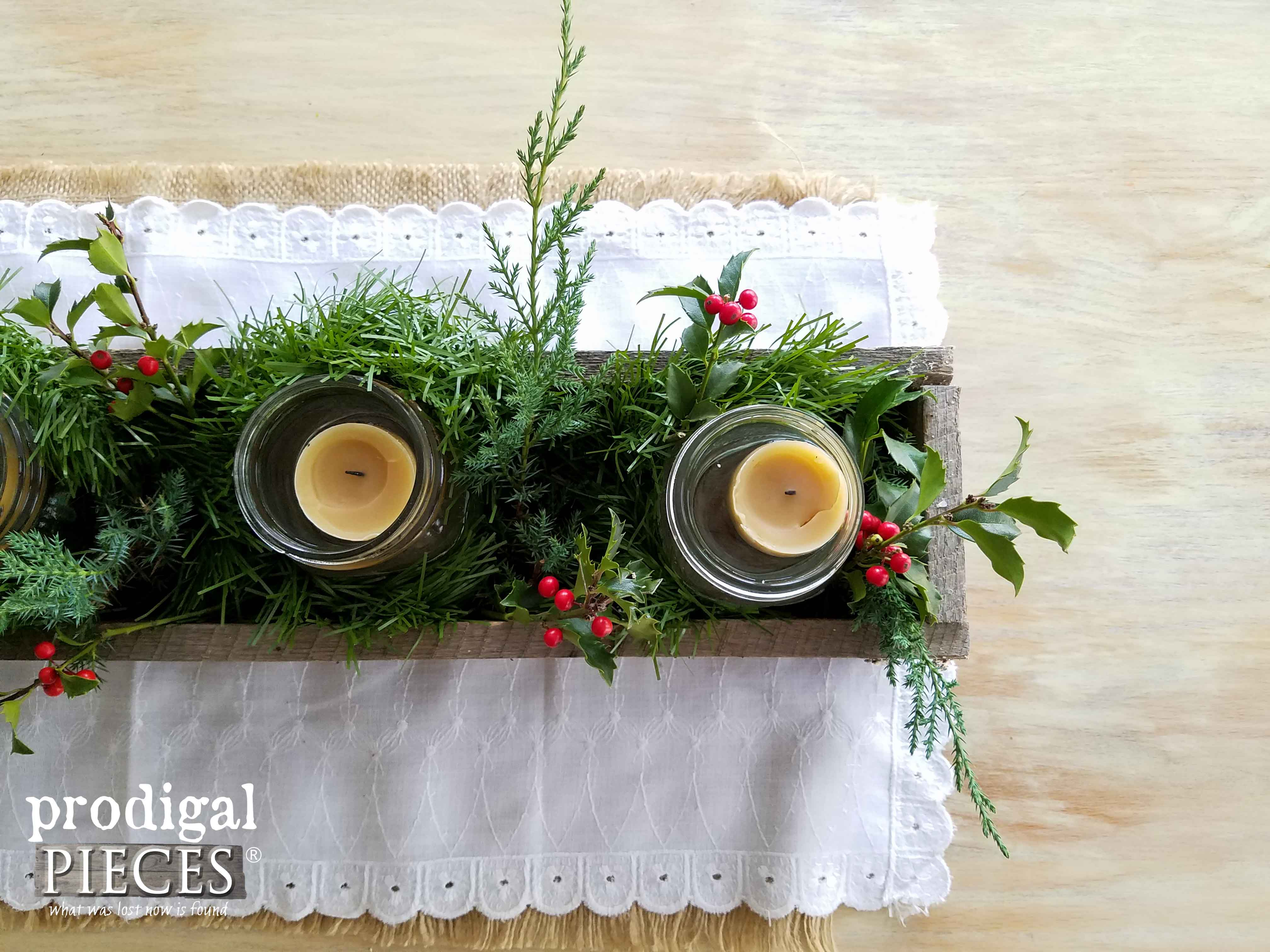 Simple Christmas Centerpiece with Pine and Holly, and Beeswax Candles in a Reclaimed Wood Trough by Prodigal Pieces | www.prodigalpieces.com