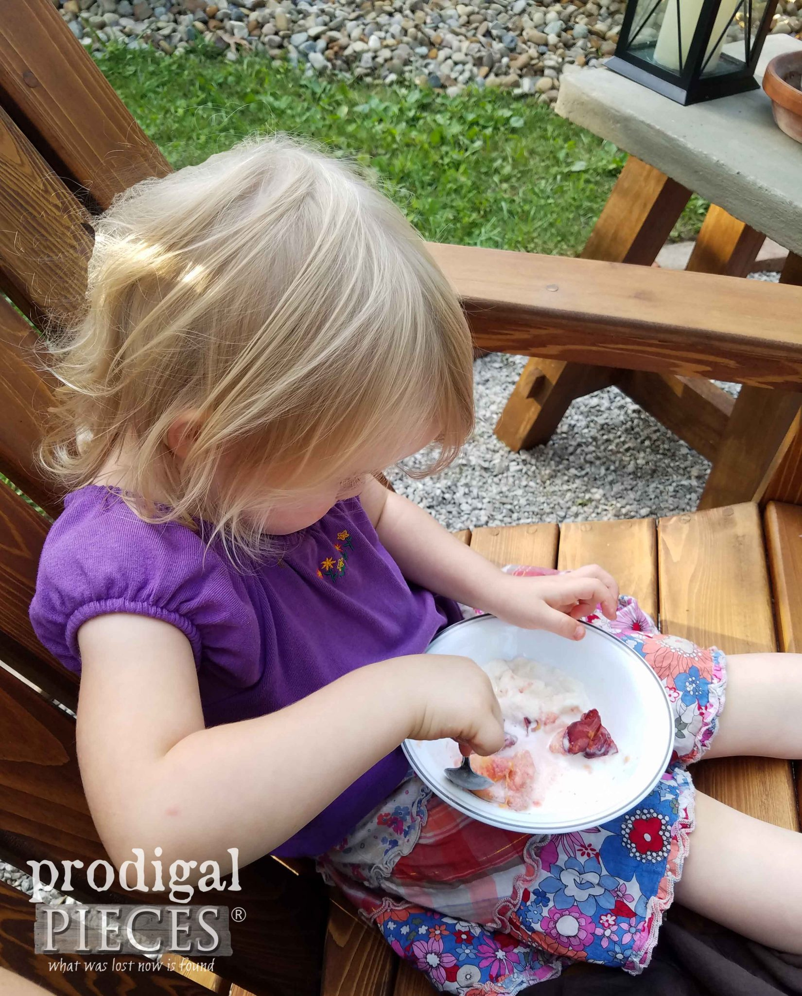 Girl Eating Roasted Stone Fruit Dessert with Recipe from Prodigal Pieces | prodigalpieces.com