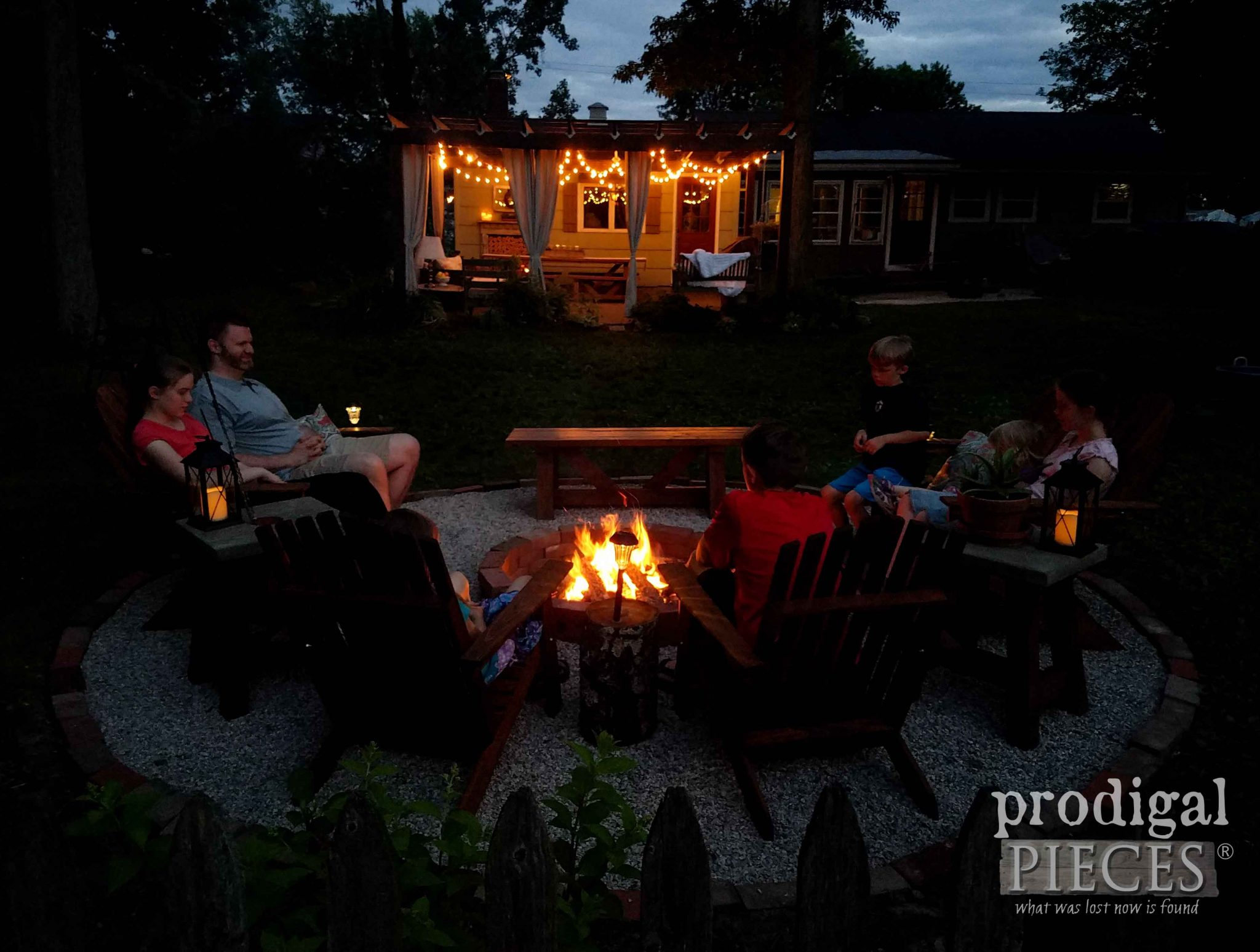 Family Gathered Around Backyard Fire Pit by Prodigal Pieces | prodigalpieces.com