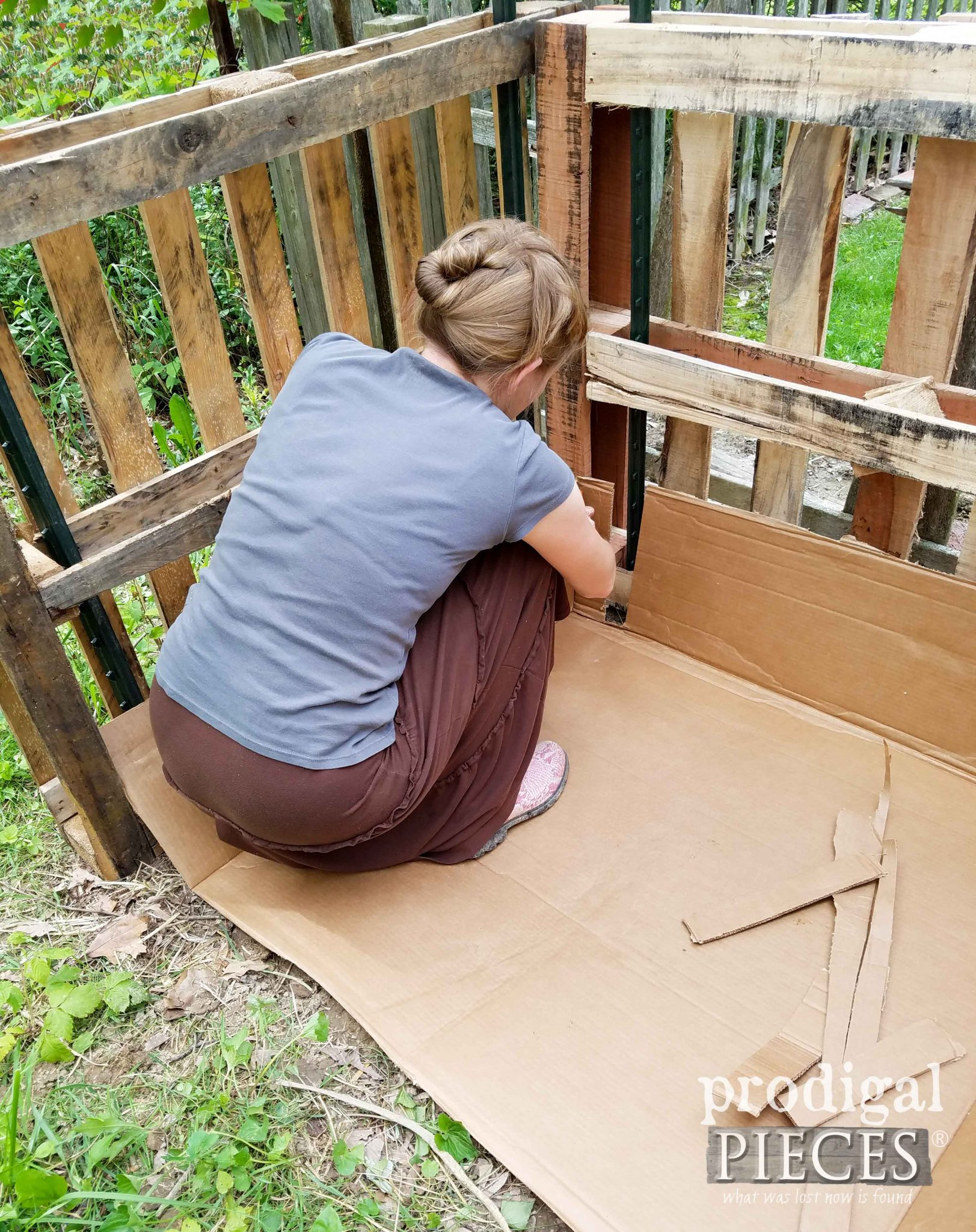 Layering Cardboard in Pallet Compost Bin by Prodigal Pieces | prodigalpieces.com