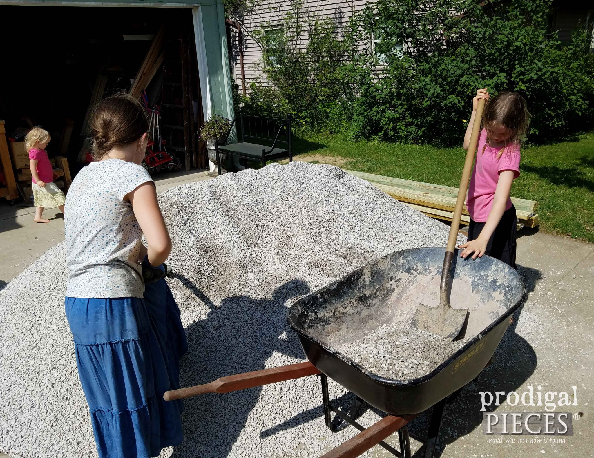 Moving Gravel for Backyard Fire Pit | prodigalpieces.com
