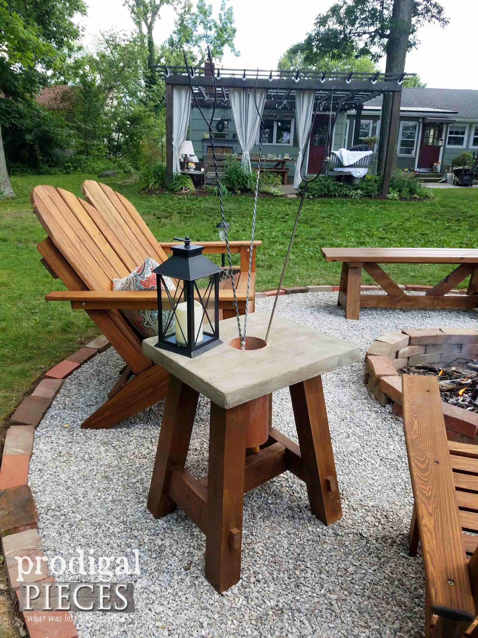 Concrete Fire Pit Table with Roasting Stick Holder by Prodigal Pieces | prodigalpieces.com