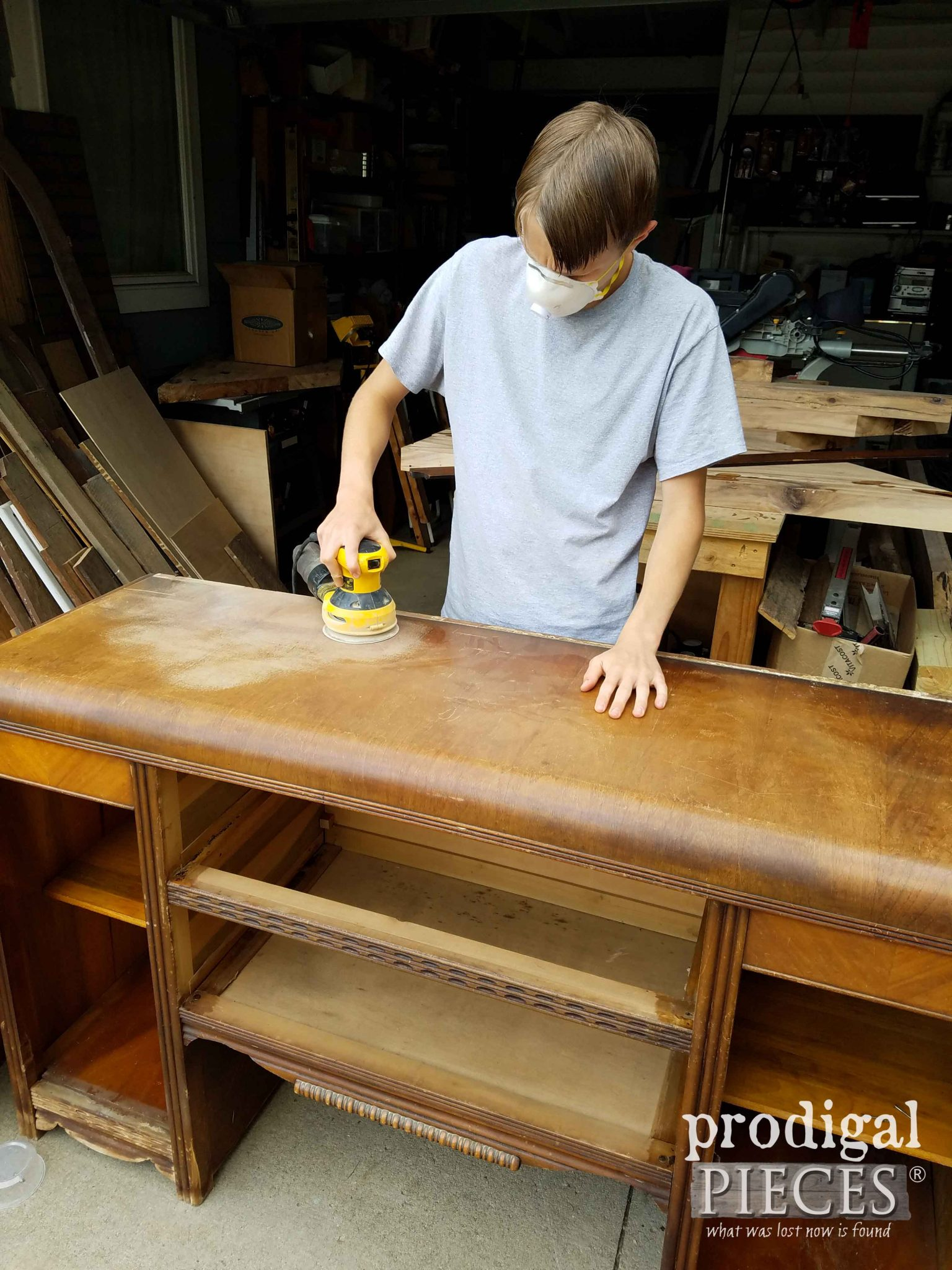 Young Man Sanding Art Decor Sideboard | prodigalpieces.com