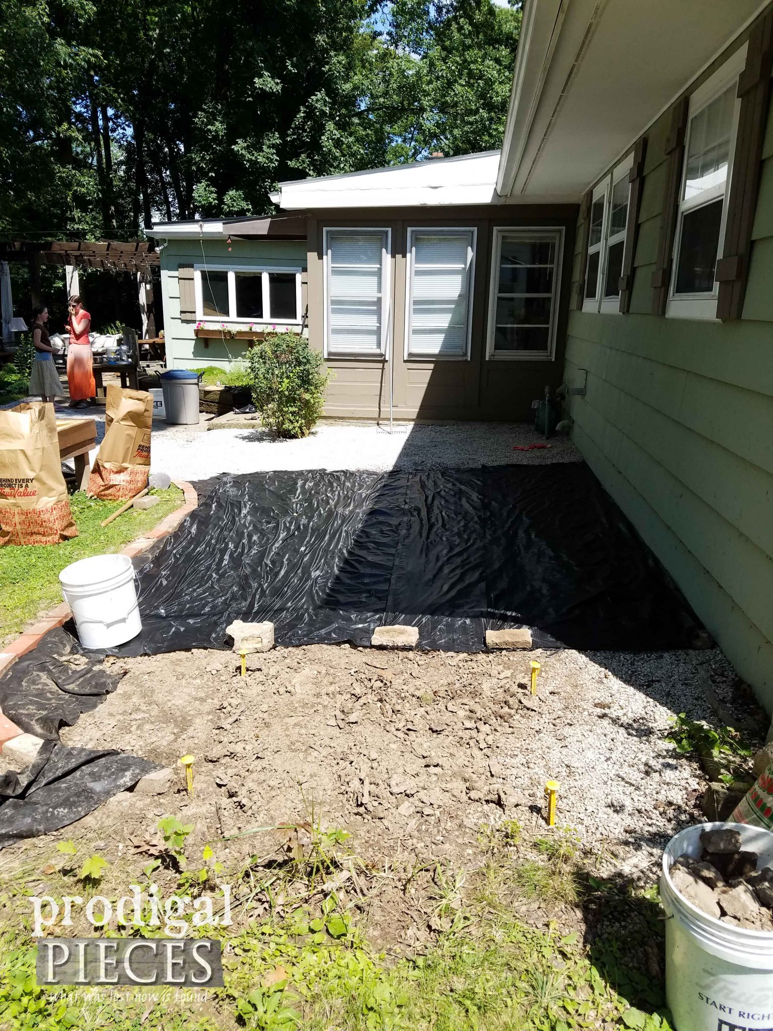Laying Down Gravel for Outdoor Play Area | prodigalpieces.com