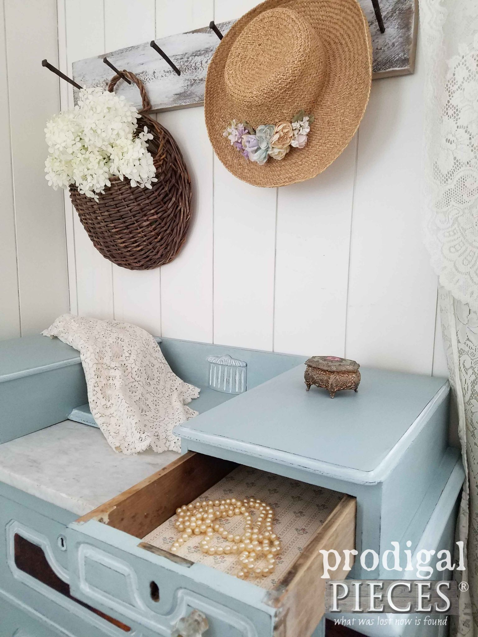 Vignette with Antique Chest, Limelight Hydrangeas, Old Pearl Necklace, and Straw Hat by Prodigal Pieces | prodigalpieces.ccom