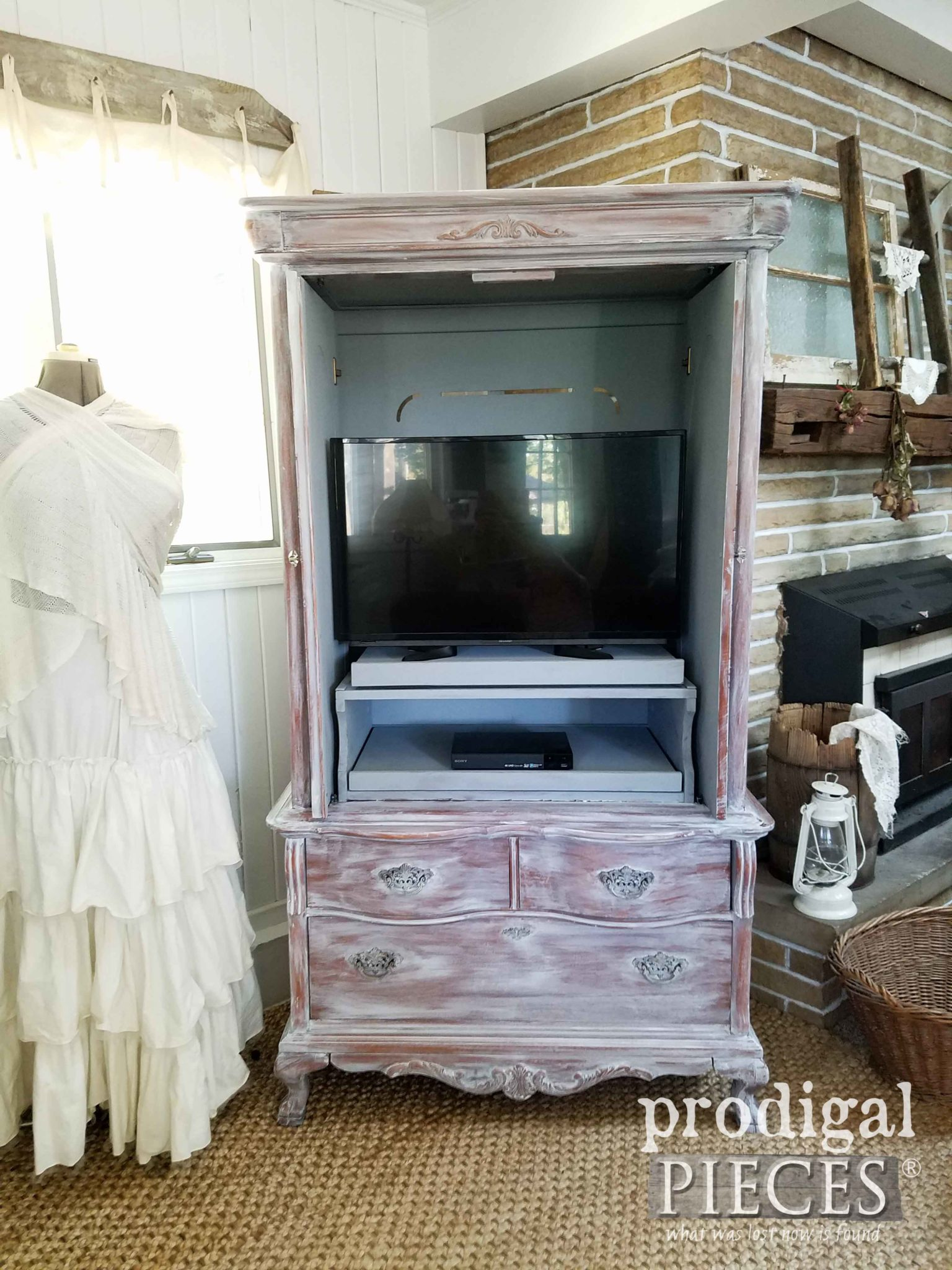 Inside of French Country Entertainminet Armoire with Whitewashed Style by Prodigal Pieces | prodigalpieces.com
