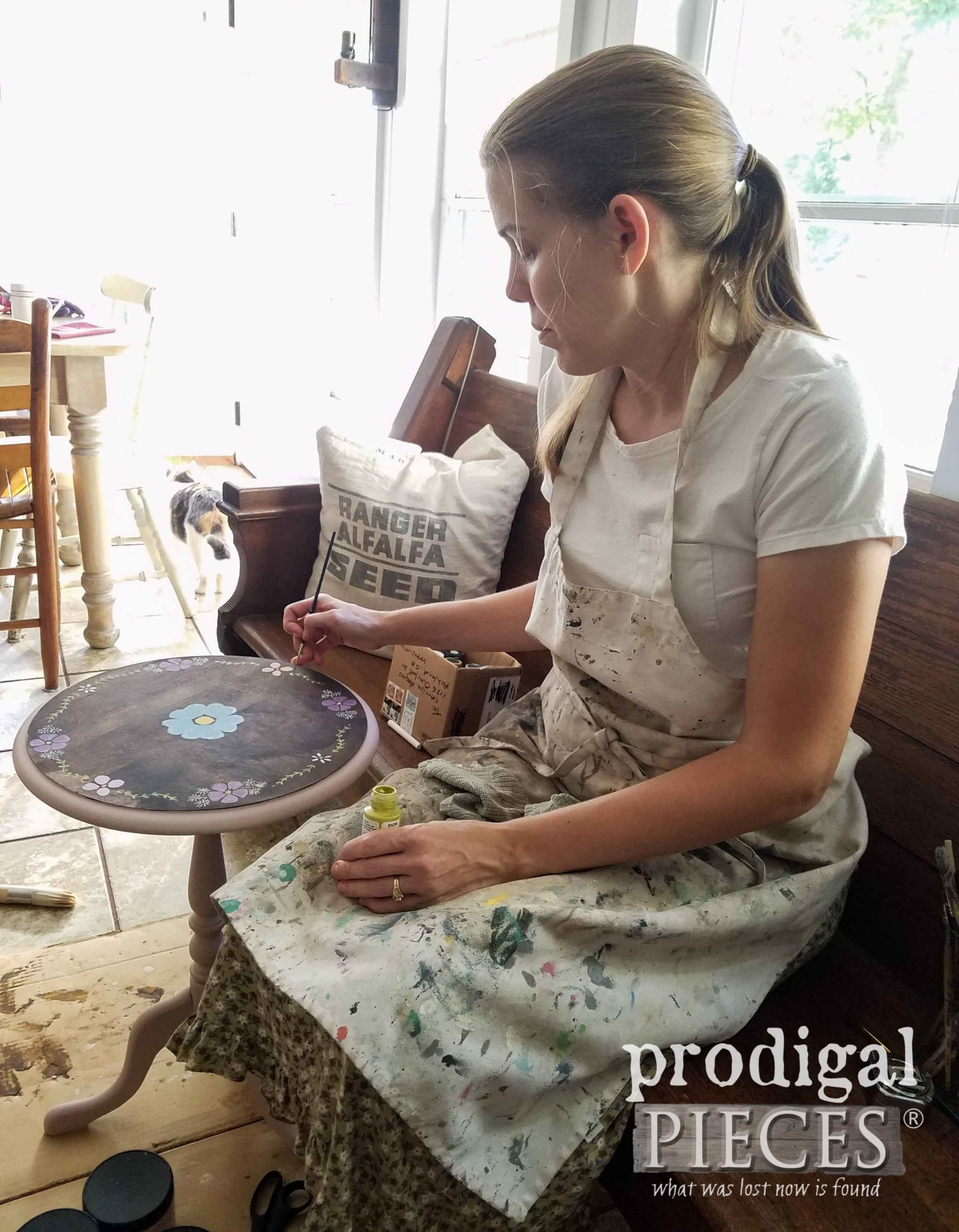 Larissa Haynes of Prodigal Pieces adding hand-painted flowers to Ethan Allen table | prodigalpieces.com