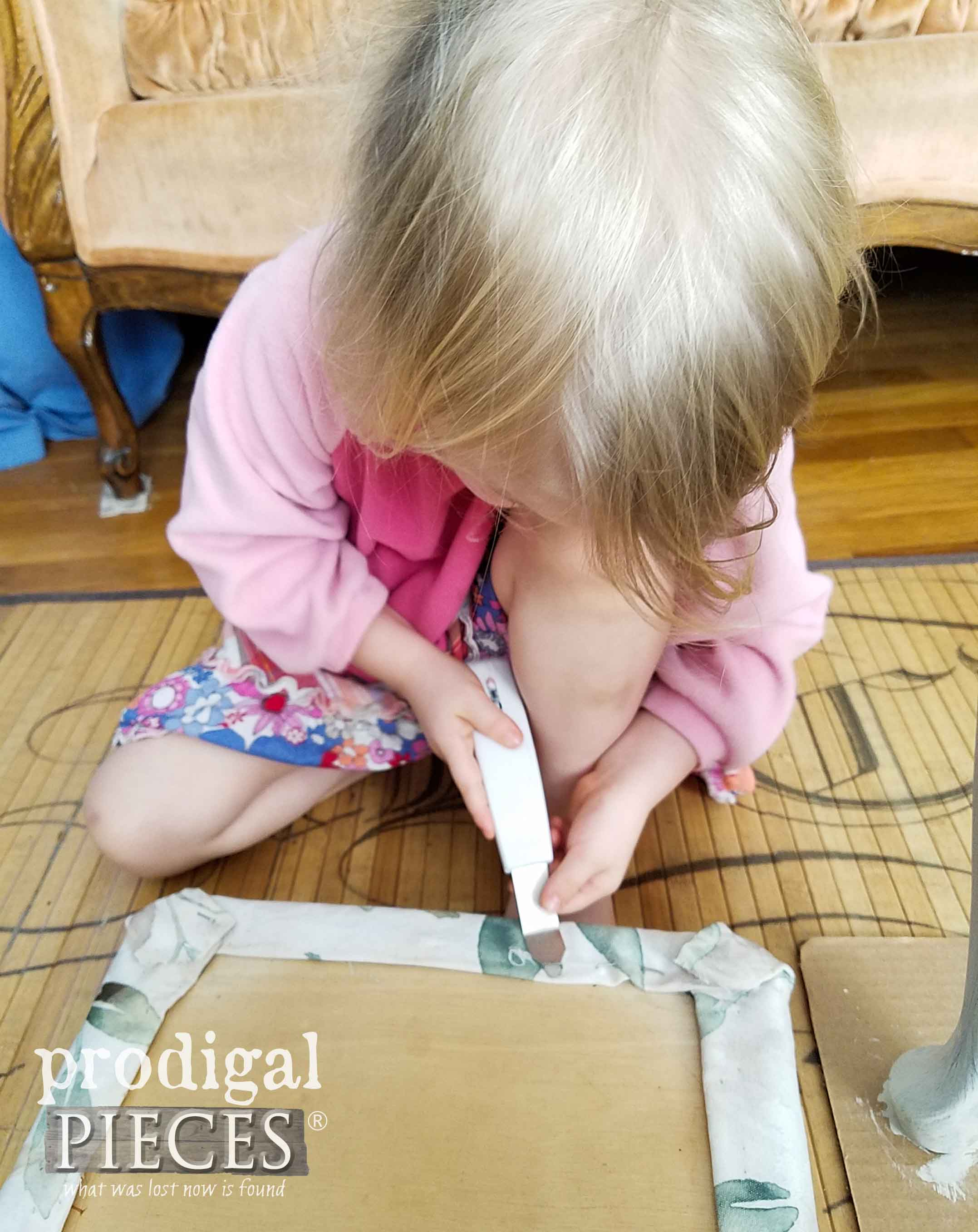 Toddler Helping Mama with Upholstery by Larissa of Prodigal Pieces | prodigalpieces.com