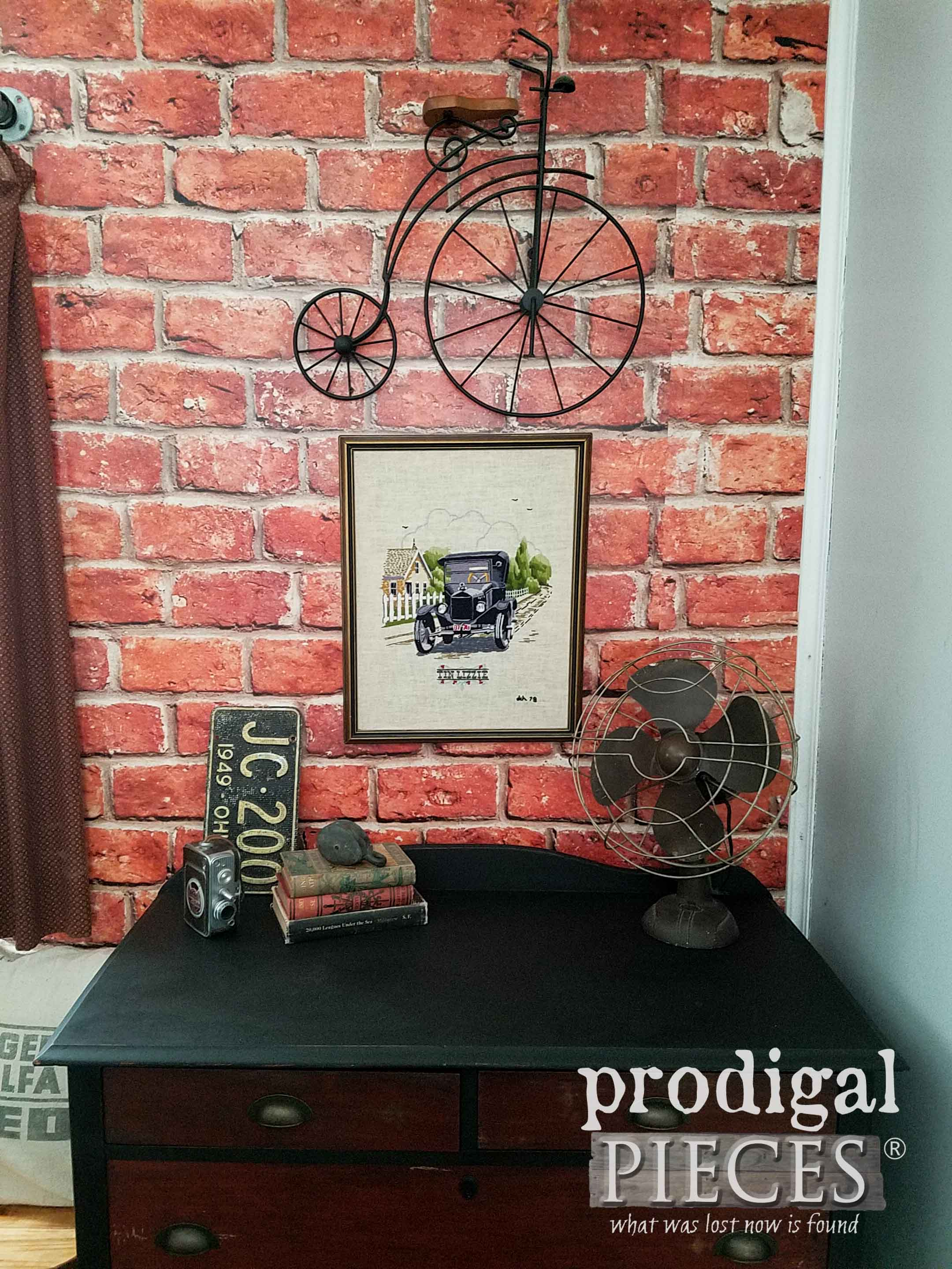 Black Chest of Drawers against Brick Wall. Makeover by Larissa of Prodigal Pieces | prodigalpieces.com