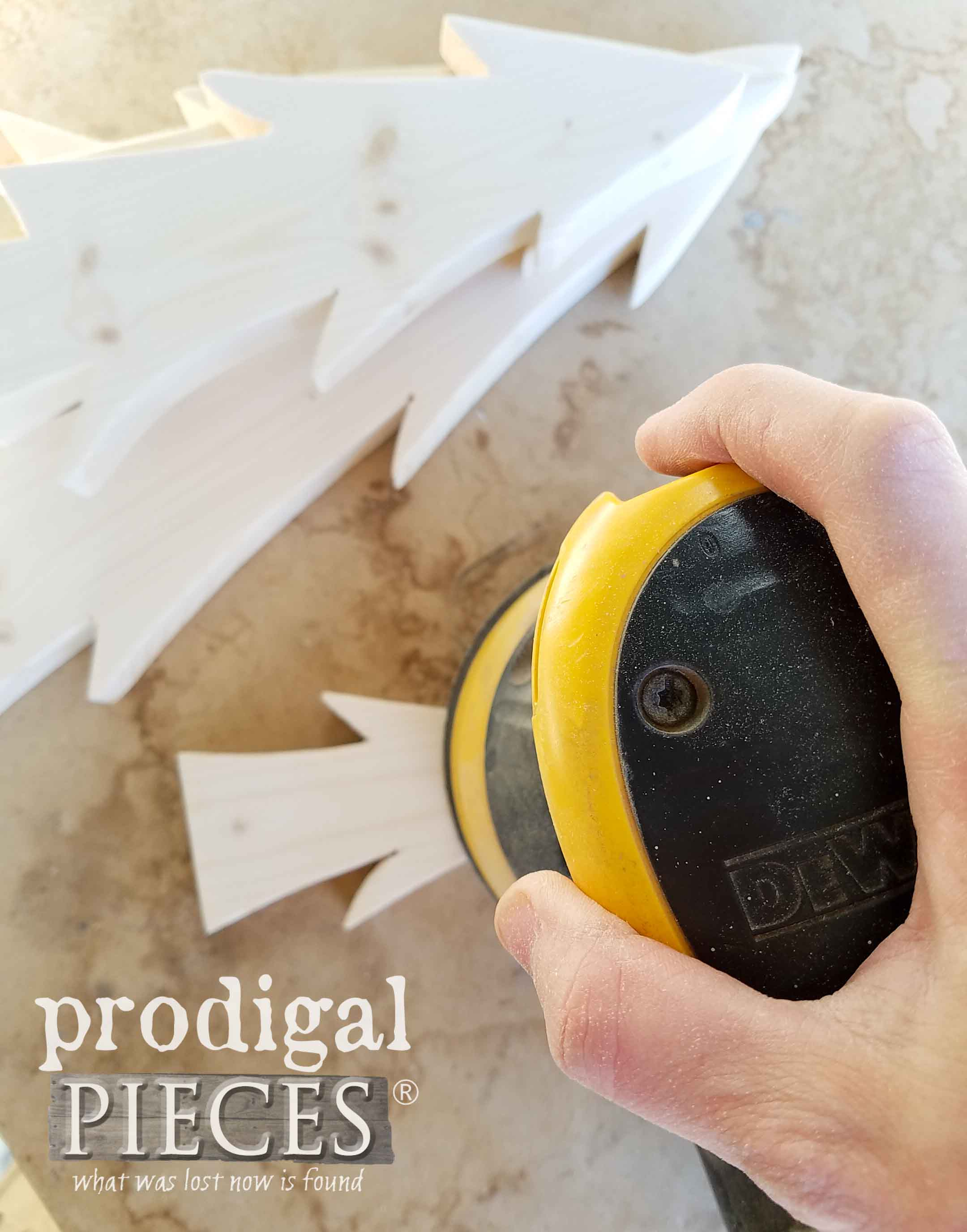 Sanding Nordic Wooden Trees by Larissa of Prodigal Pieces | prodigalpieces.com