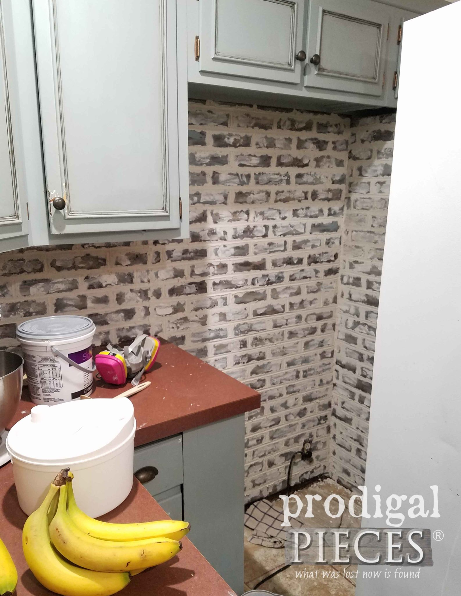 Faux Whitewashed Brick Behind Refrigerator | prodigalpieces.com