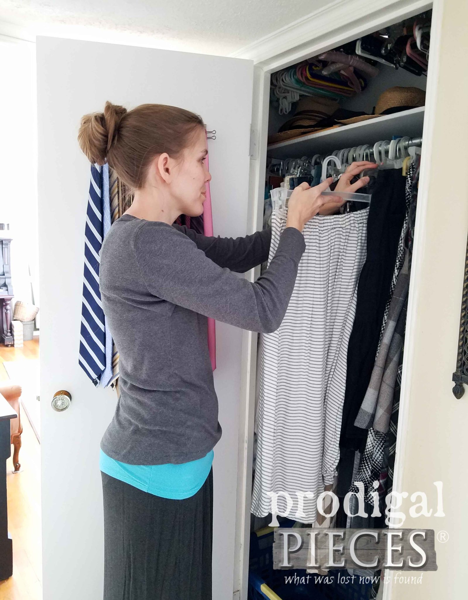 Hanging Clothes in Closet during Spring Cleaning | prodigalpieces.com