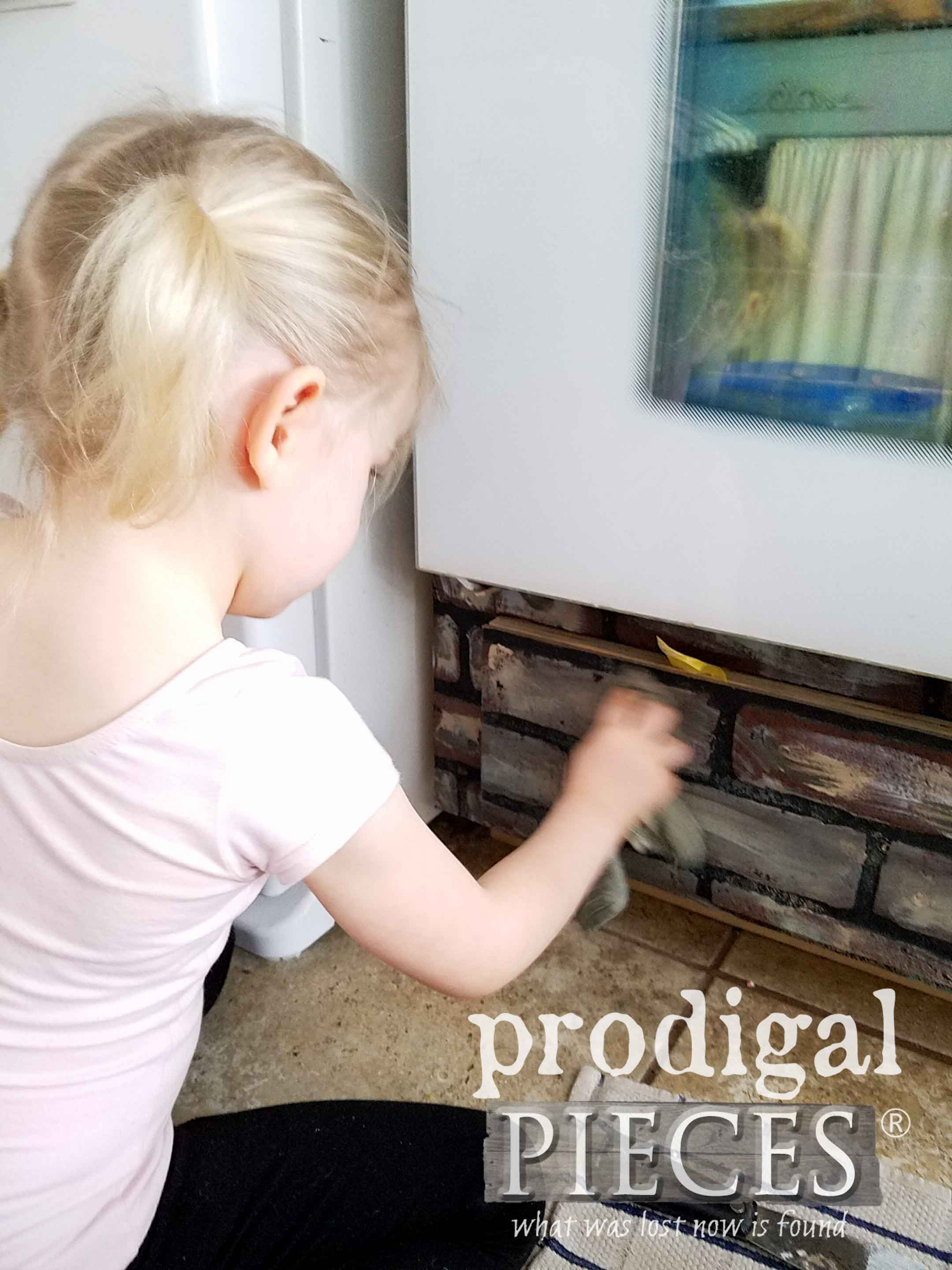 Toddler Helping Mama with Faux Brick Treatment | prodigalpieces.com