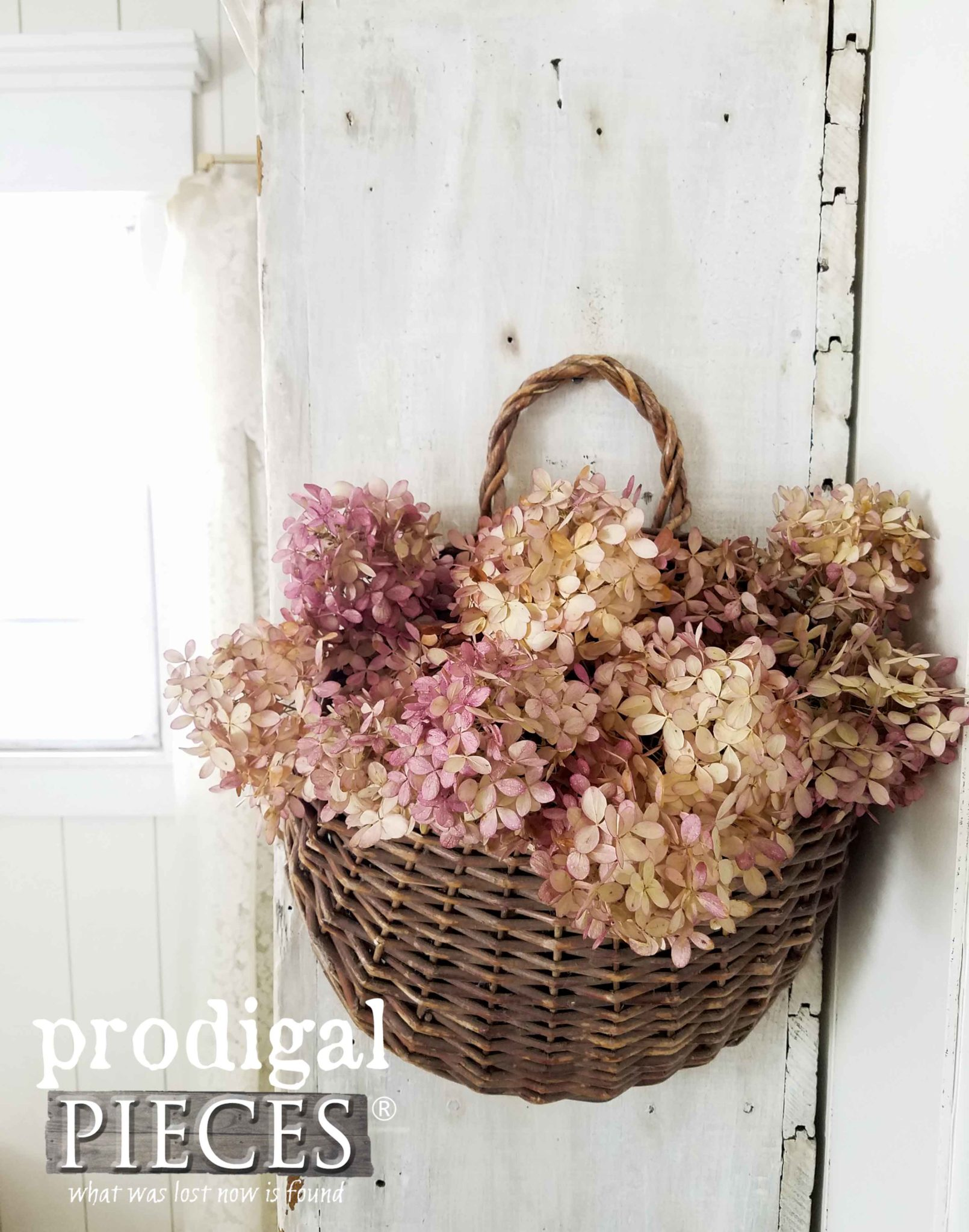 Dried Hydrangea Arrangement in Hanging Basket by Prodigal Pieces | prodigalpieces.com