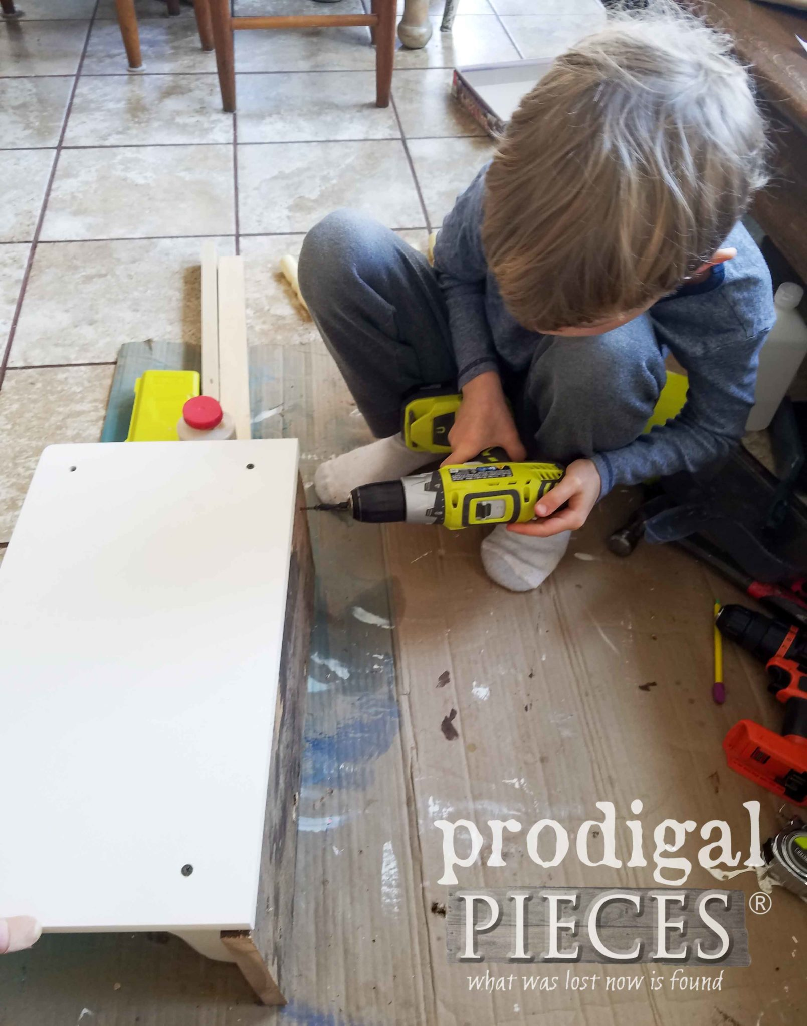 Boy Using Drill to Make Reclaimed Wood Shelf | prodigalpieces.com