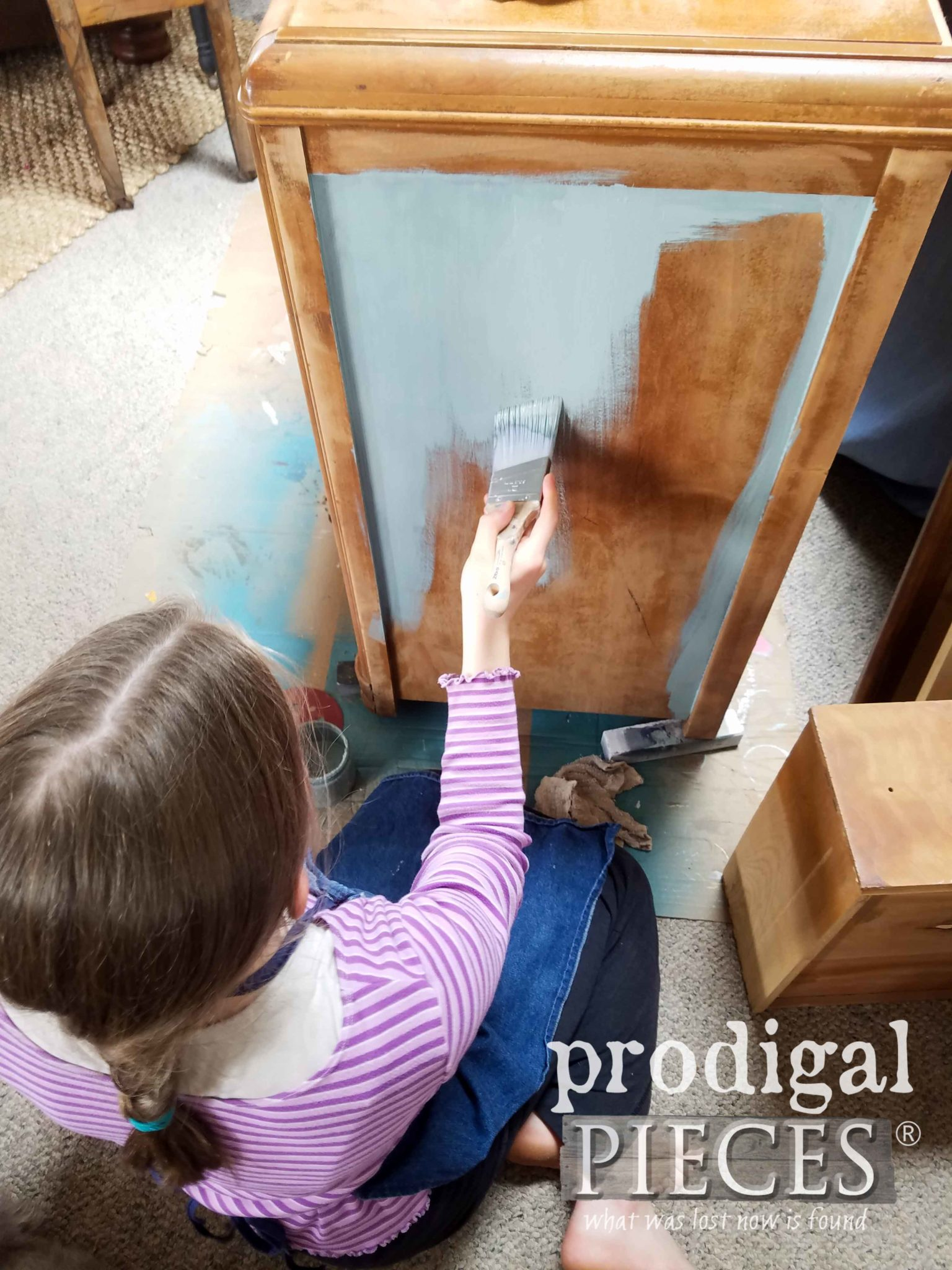 Girl Painting Vintage Art Deco Waterfall Dresser in Vintage Duck Egg by Prodigal Pieces | prodigalpieces.com