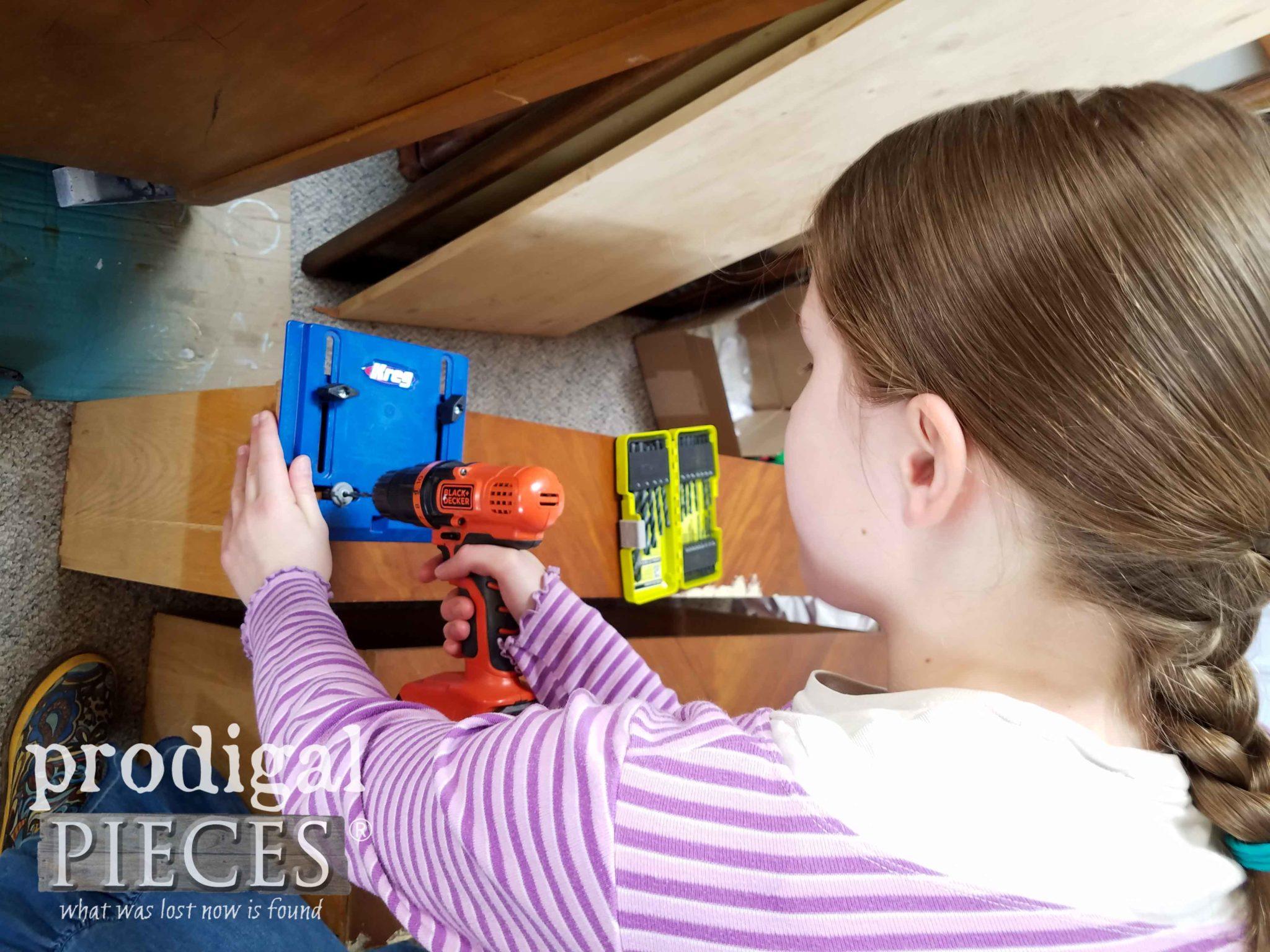 Girl Using Kreg Jig for Dresser Hardware | prodigalpieces.com