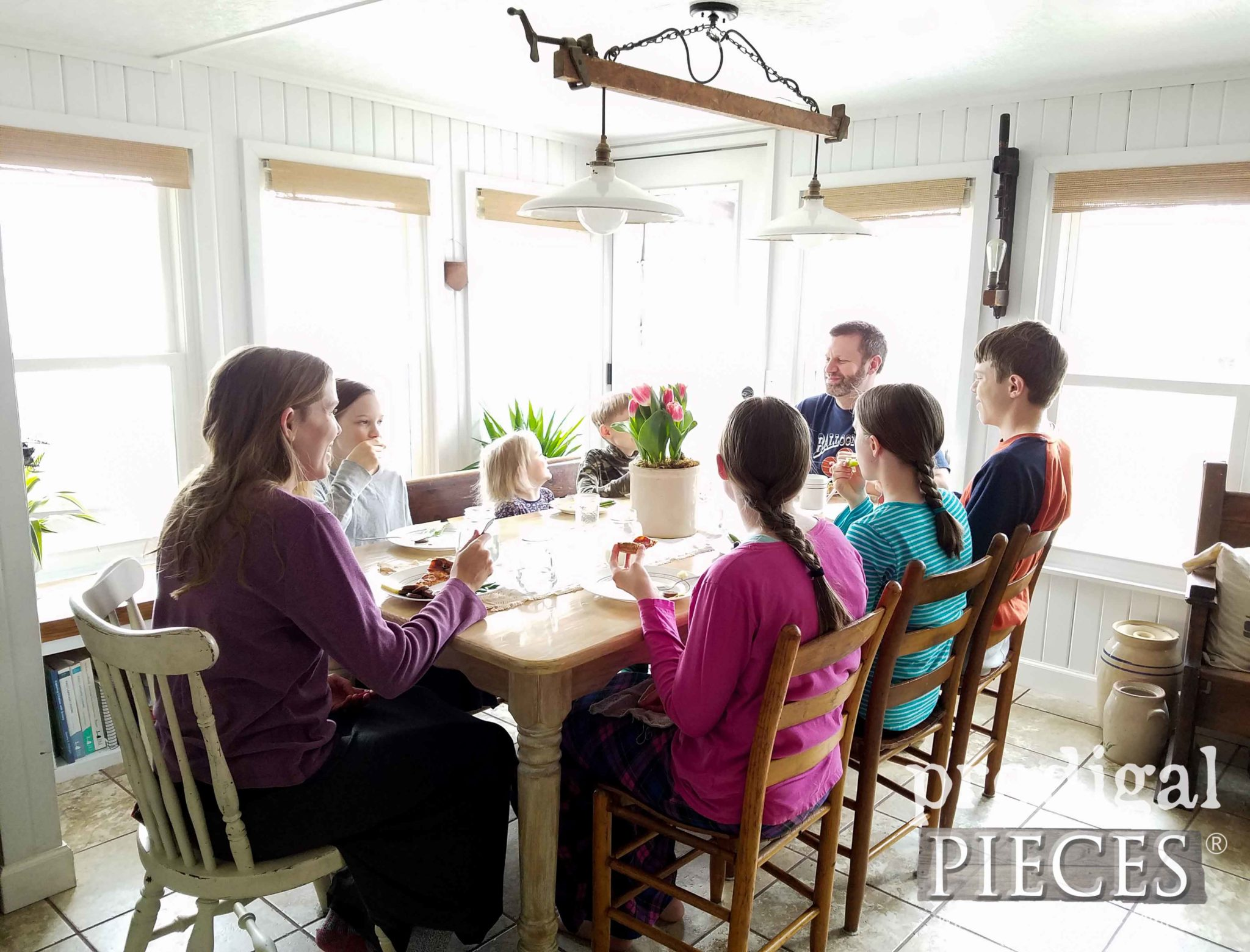 JC & Larissa of Prodigal Pieces Dining with her Family of 8 in their farmhouse kitchen | prodigalpieces.com