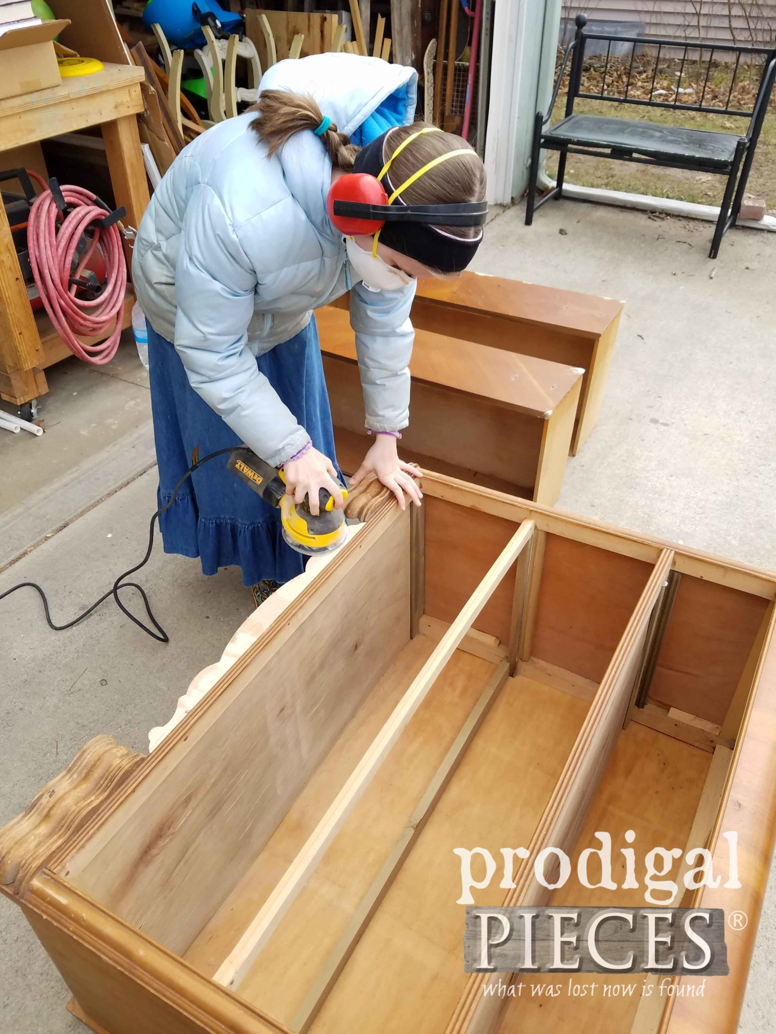 Tween Girl Using Orbital Sander to Repair Vintage Dresser | prodigalpieces.com